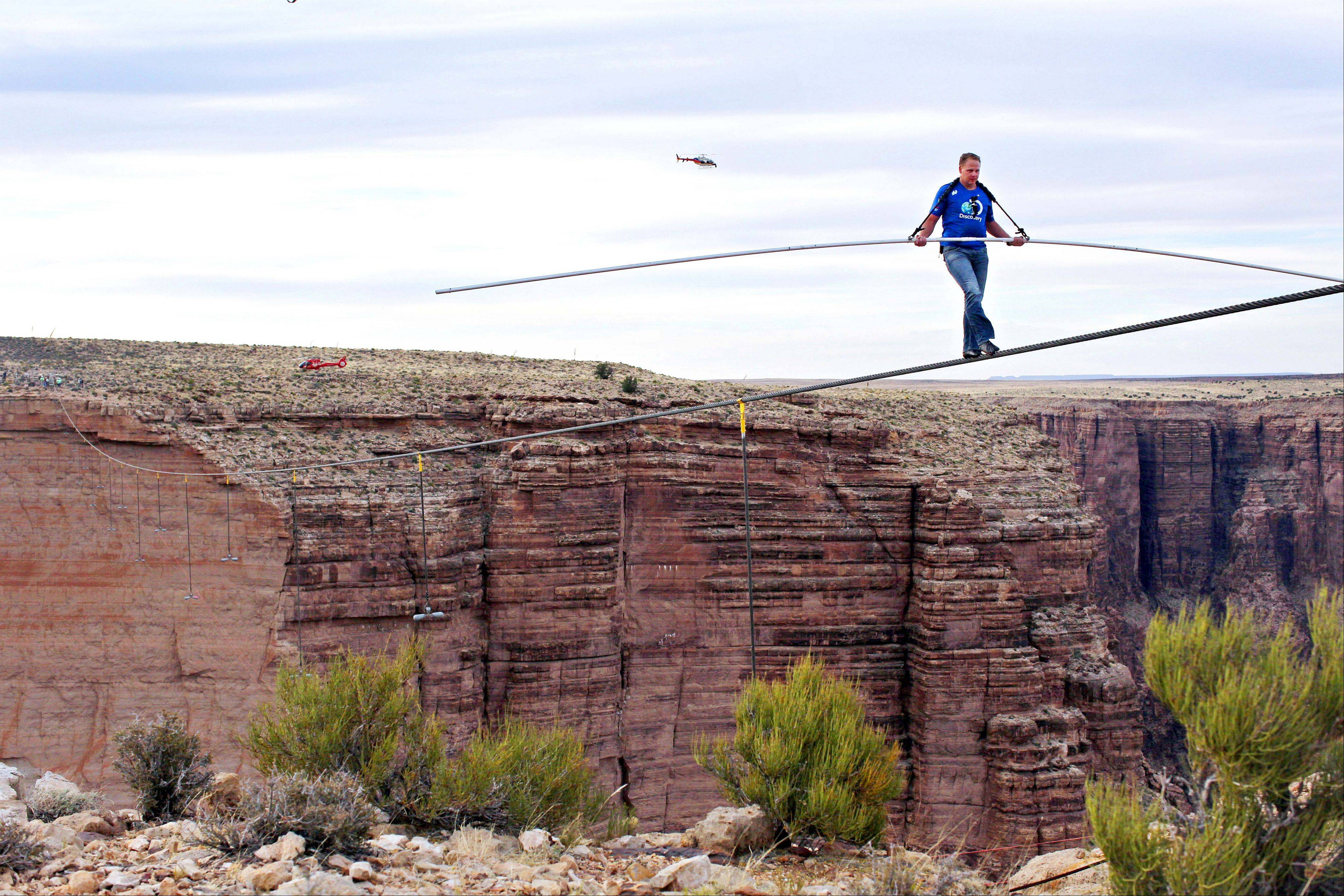 Aerialist Nik Wallenda near the end of his quarter mile walk over the Little Colorado River Gorge in northeastern Arizona on Sunday, June 23, 2013. The daredevil successfully traversed the tightrope strung 1,500 feet above the chasm near the Grand Canyon in just more than 22 minutes, pausing and crouching twice as winds whipped around him and the cable swayed.