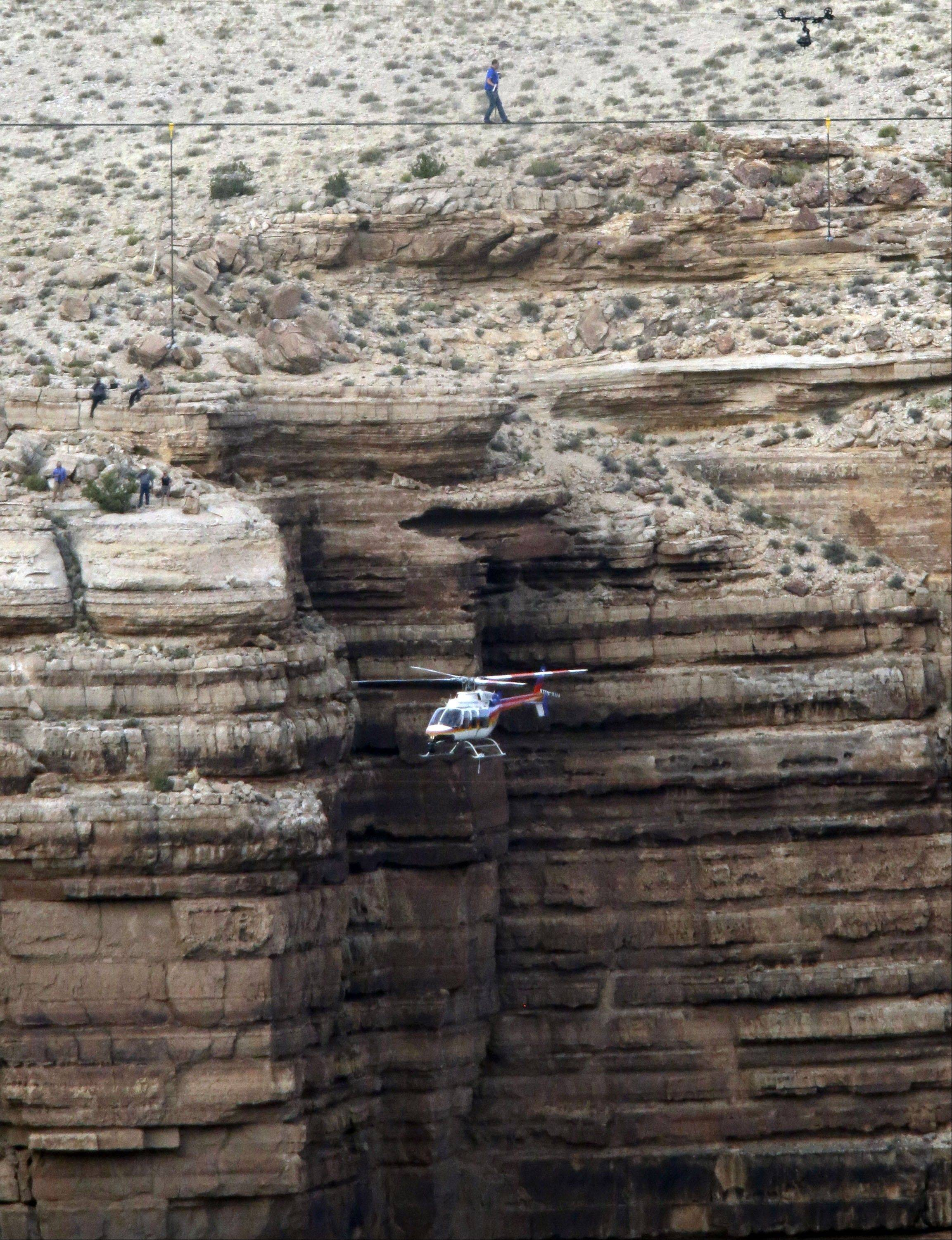 Daredevil Nik Wallenda crosses a tightrope 1,500 feet above the Little Colorado River Gorge Sunday, June 23, 2013, on the Navajo reservation outside the boundaries of Grand Canyon National Park.