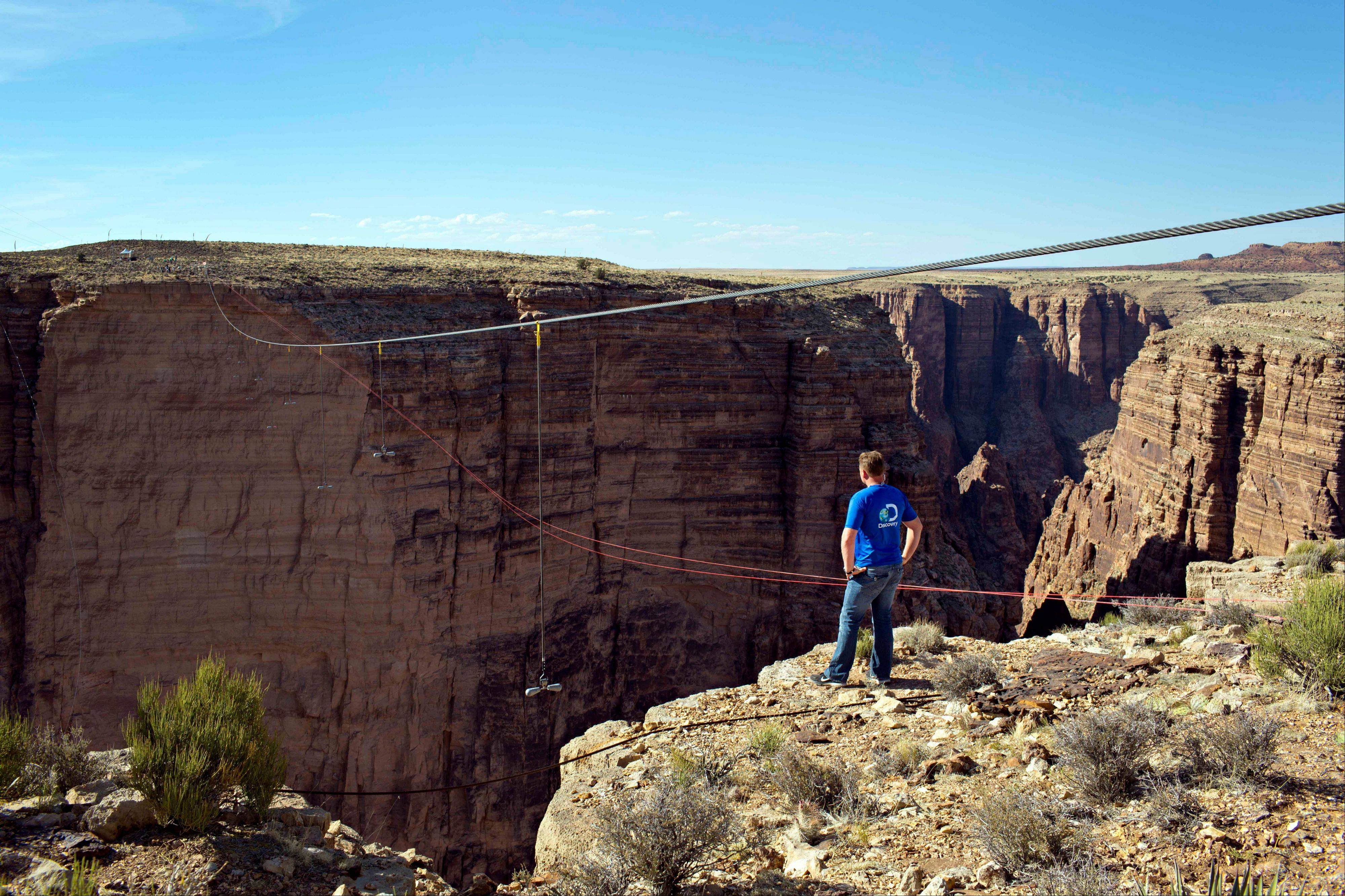 Aerialist Nik Wallenda looks across the canyon before walking a 2-inch-thick steel cable that took him a quarter mile over the Little Colorado River Gorge in northeastern Arizona on Sunday, June 23, 2013. The daredevil successfully traversed the tightrope strung 1,500 feet above the chasm near the Grand Canyon in just more than 22 minutes, pausing and crouching twice as winds whipped around him and the cable swayed.