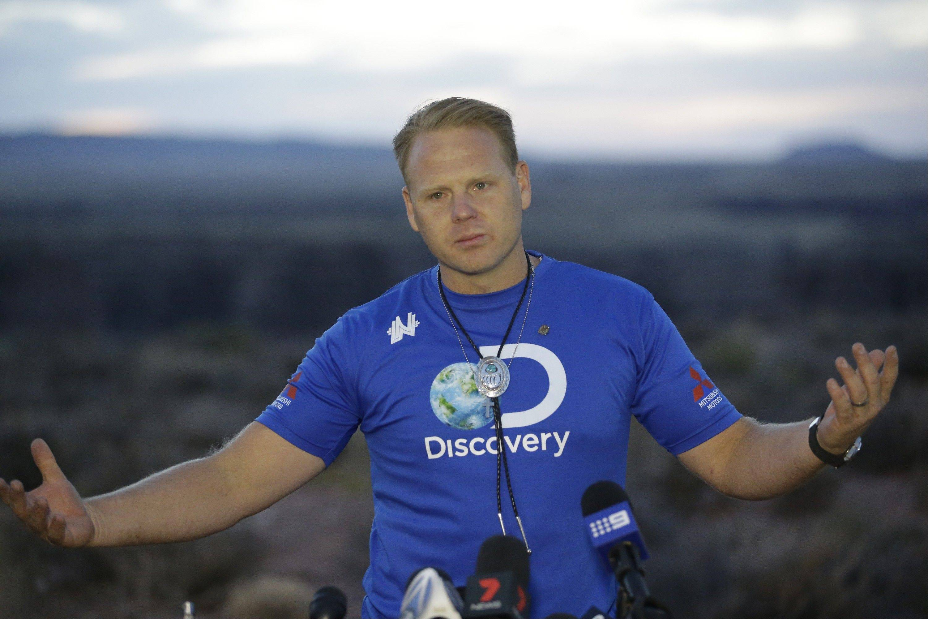 Daredevil Nik Wallenda smiles during a news conference after crossing a tightrope 1,500 feet above the Little Colorado River Gorge Sunday, June 23, 2013, on the Navajo reservation outside the boundaries of Grand Canyon National Park. Wallenda completed the tightrope walk that took him a quarter mile across the gorge in just more than 22 minutes.