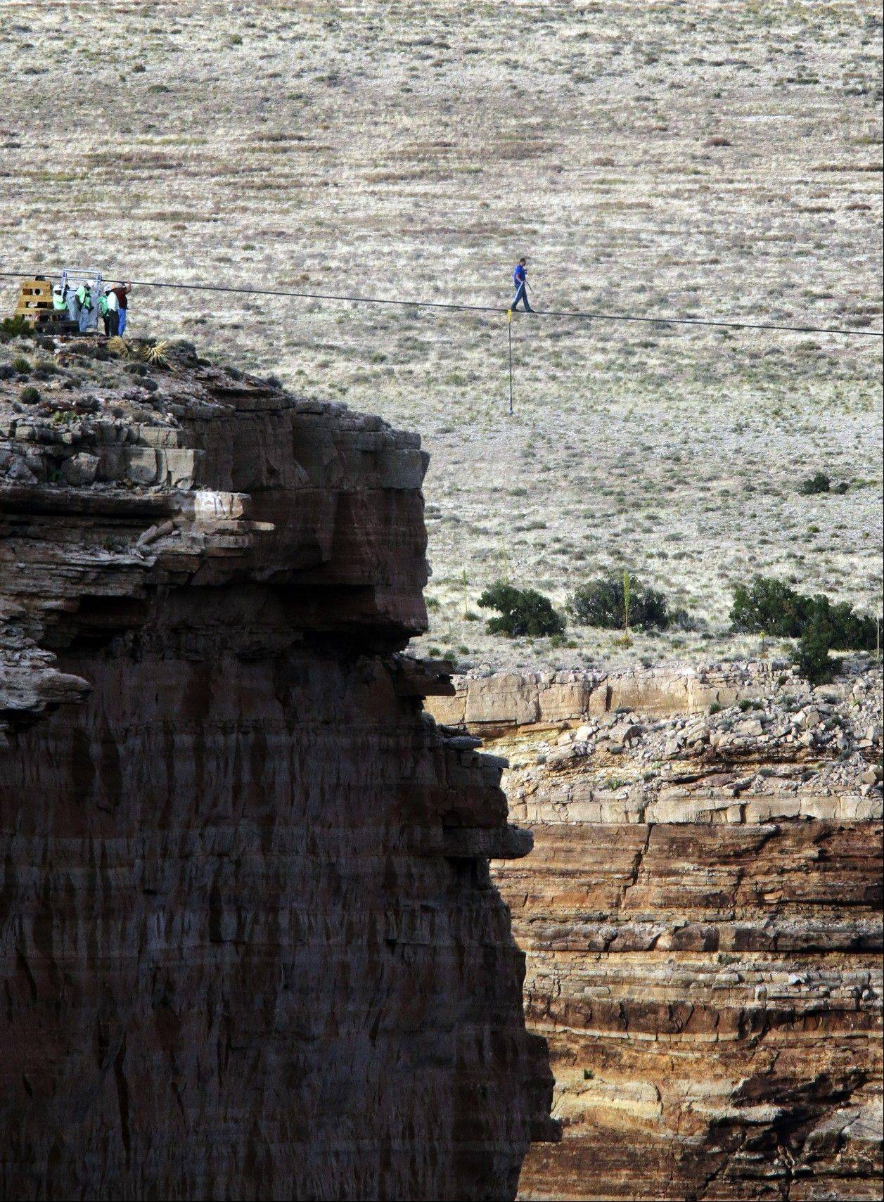 Daredevil Nik Wallenda crosses a tightrope 1,500 feet above the Little Colorado River Gorge, Ariz., on Sunday, June 23, 2013, on the Navajo Nation outside the boundaries of Grand Canyon National Park. Wallenda completed the tightrope walk that took him a quarter mile over the gorge in just more than 22 minutes.