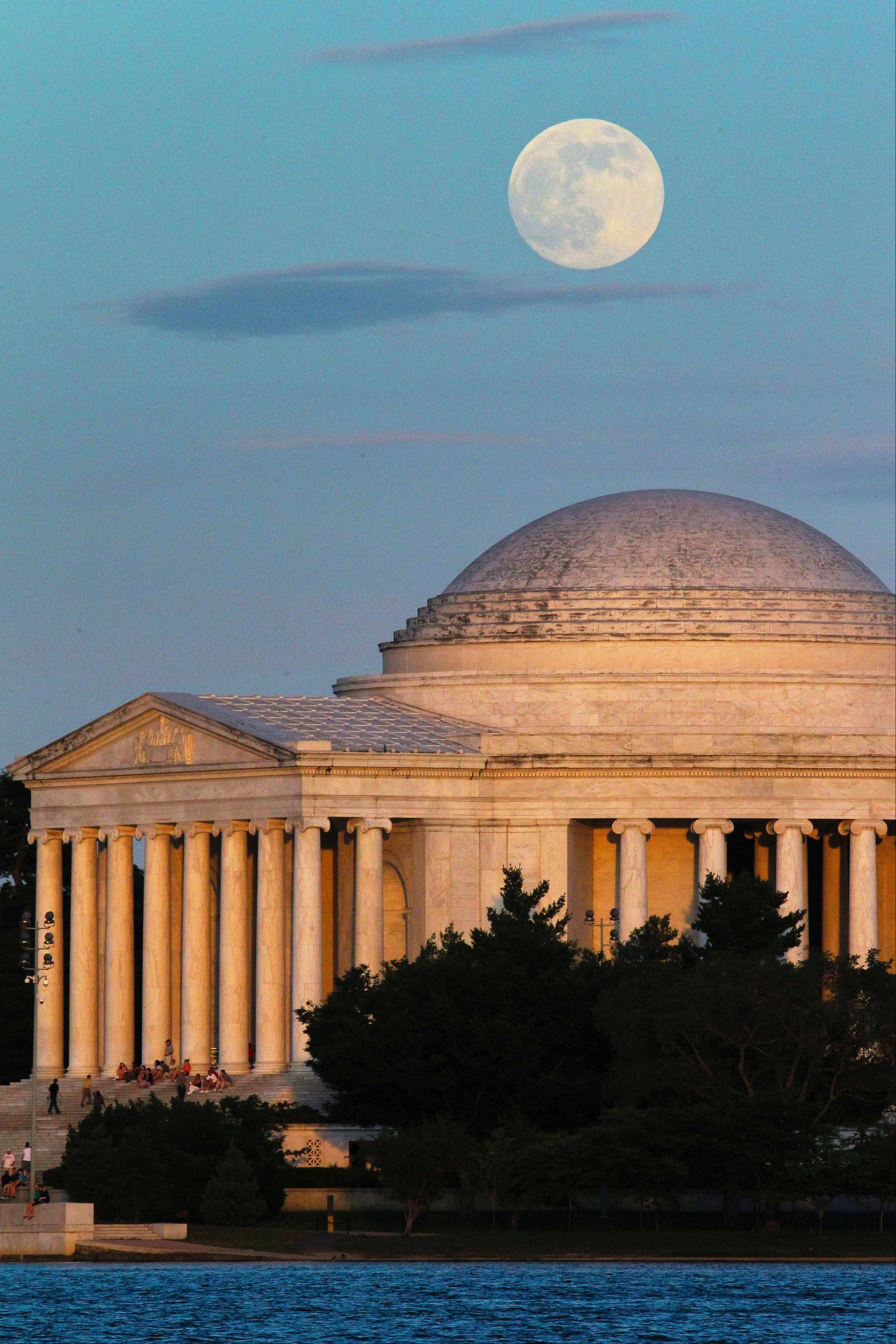 "A full moon rises behind the Jefferson Memorial in Washington Saturday, June 22, 2013. The larger than normal moon called the ""Supermoon"" happens only once this year as the moon on its elliptical orbit is at its closest point to earth."