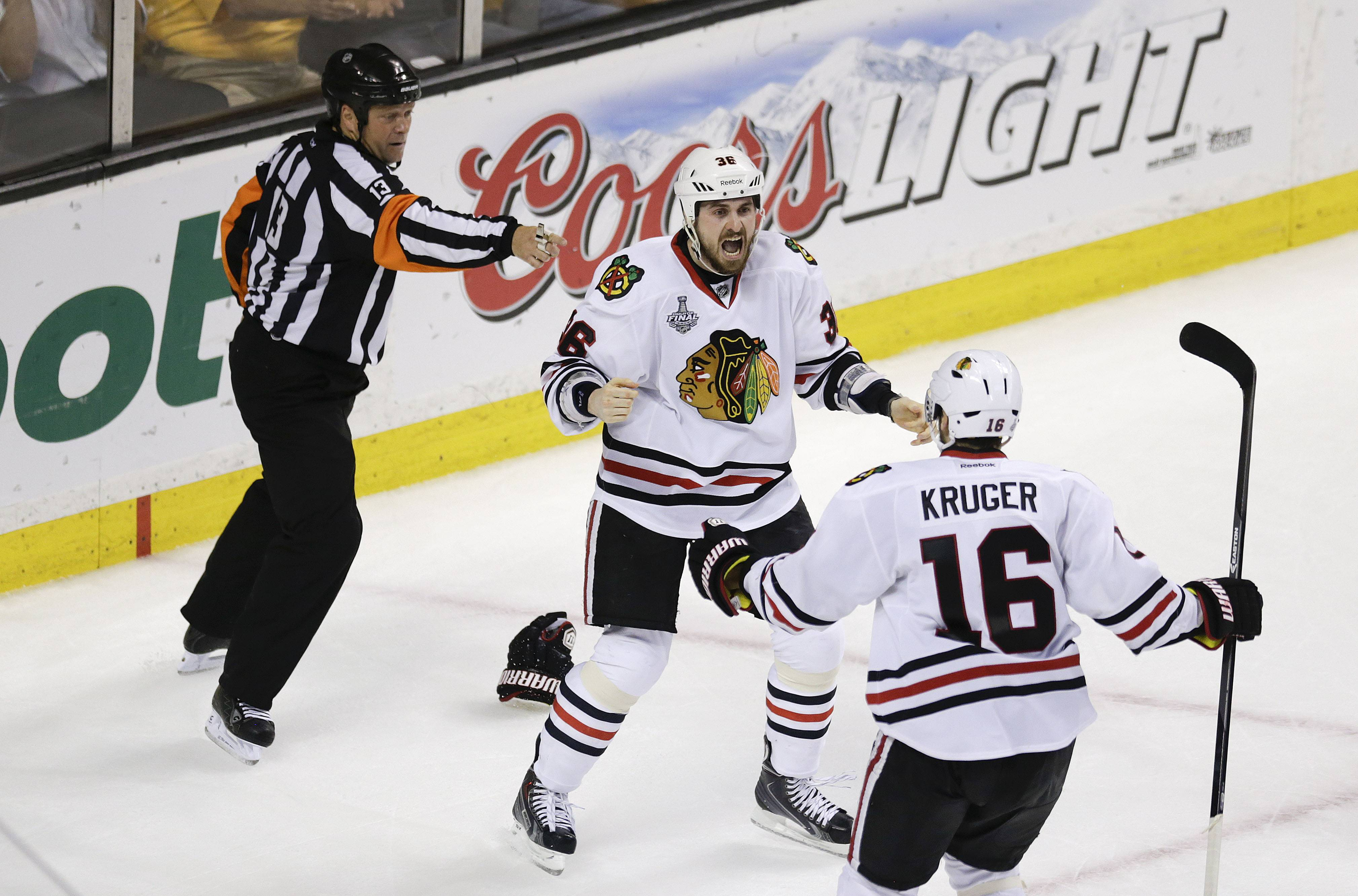 Blackhawks center Dave Bolland (36) celebrates his game winning goal against the Boston Bruins with  Blackhawks center Marcus Kruger (16) Monday during the third period in Game 6 of the Stanley Cup Finals in Boston. The Blackhawks won 3-2.