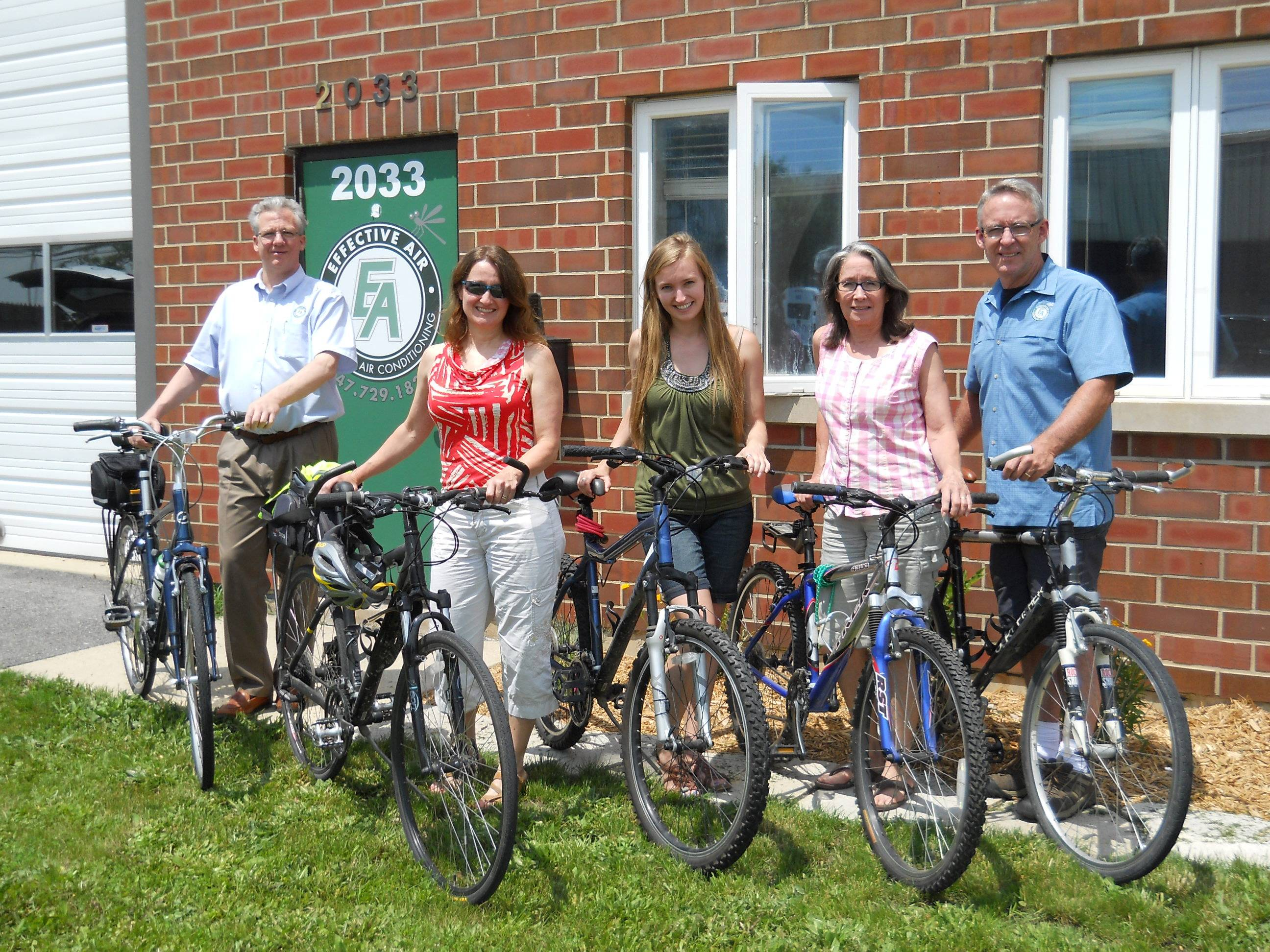 The office staff with their bikes outside their office in Glenview. From left to right: Ken (Office Assistant), Kim (President), Tracey (Executive Assistant), Janet (Office Assistant) & Jon (CEO)