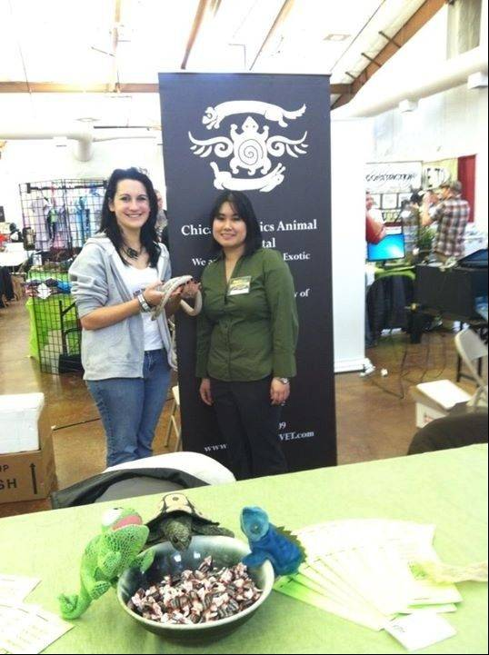 Erica Mede and Dr. Stephanie Moy pose with Mede�s black rat snake, Vader, at the Chicago Exotic Animal Hospital�s information booth. Vader will accompany Mede to this year�s Chicagoland Repticon at the Kane County Fairgrounds Prairie Events Center, set for Saturday and Sunday, June 29-30.
