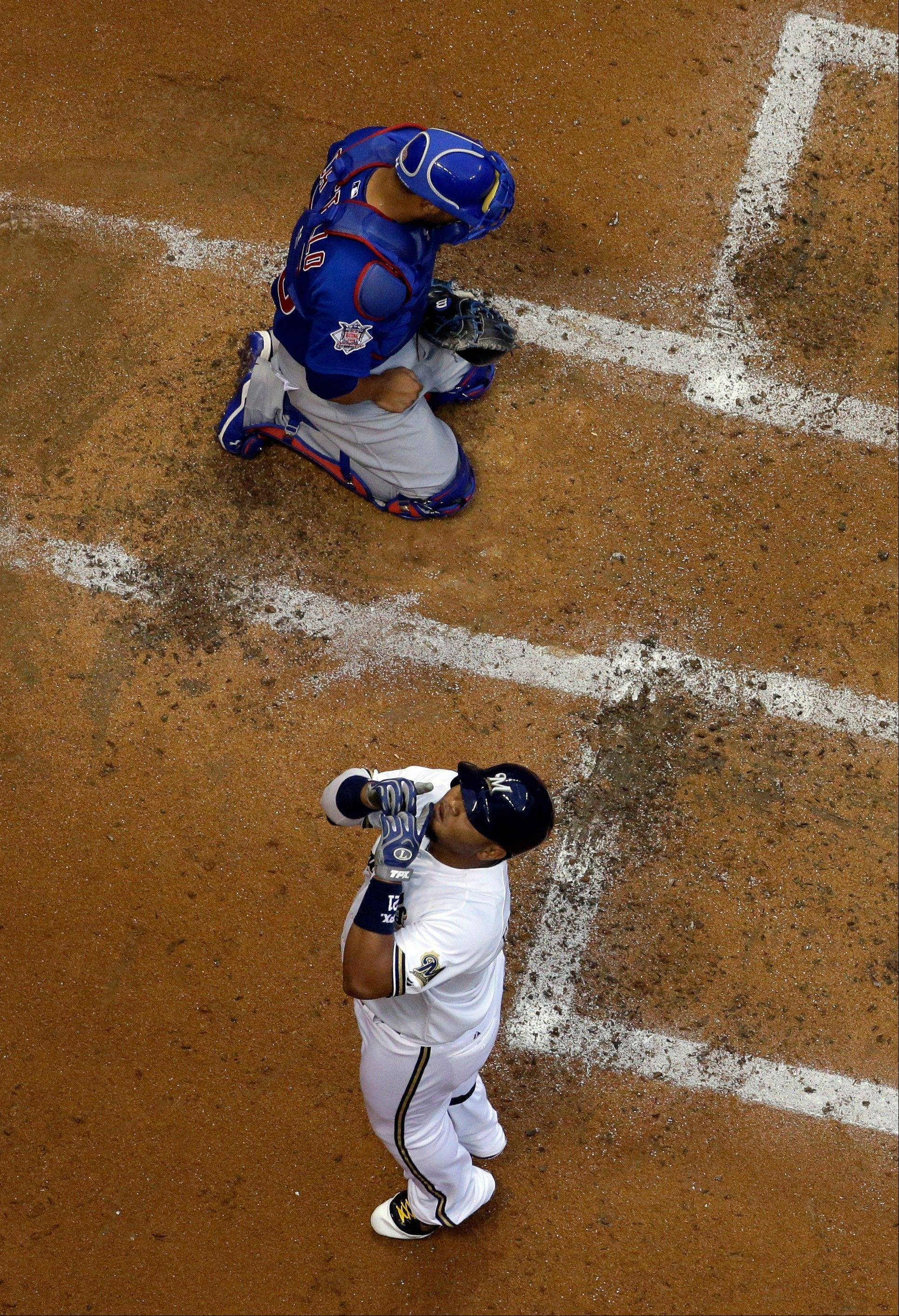 Milwaukee Brewers' Juan Francisco reacts in front of Chicago Cubs catcher Welington Castillo after Francisco hit a home run during the second inning of a baseball game Tuesday, June 25, 2013, in Milwaukee. (AP Photo/Morry Gash)