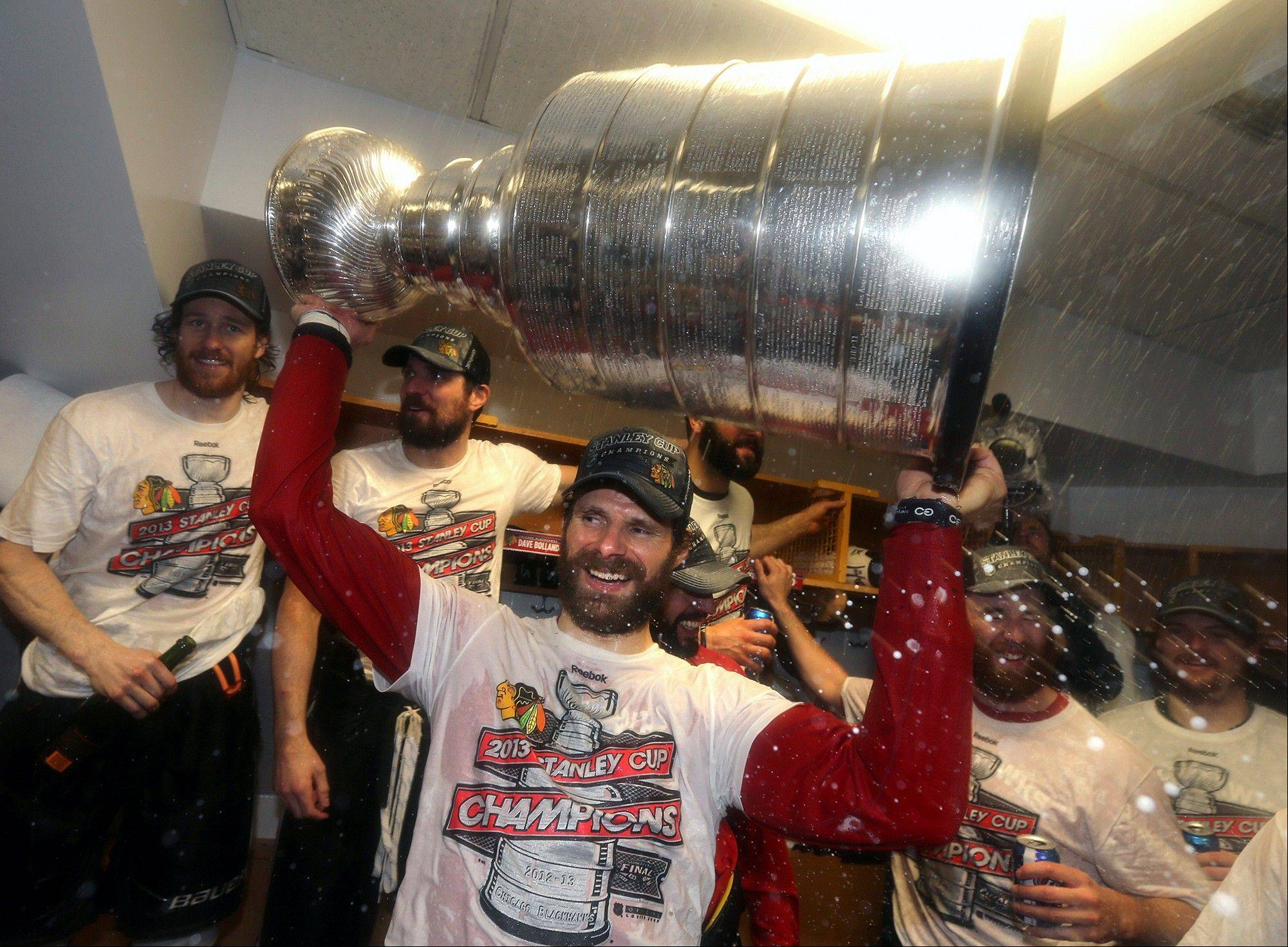 Blackhawks center Michal Handzus gets to celebrate with the Stanley Cup for the first time in his career following Monday night's game.