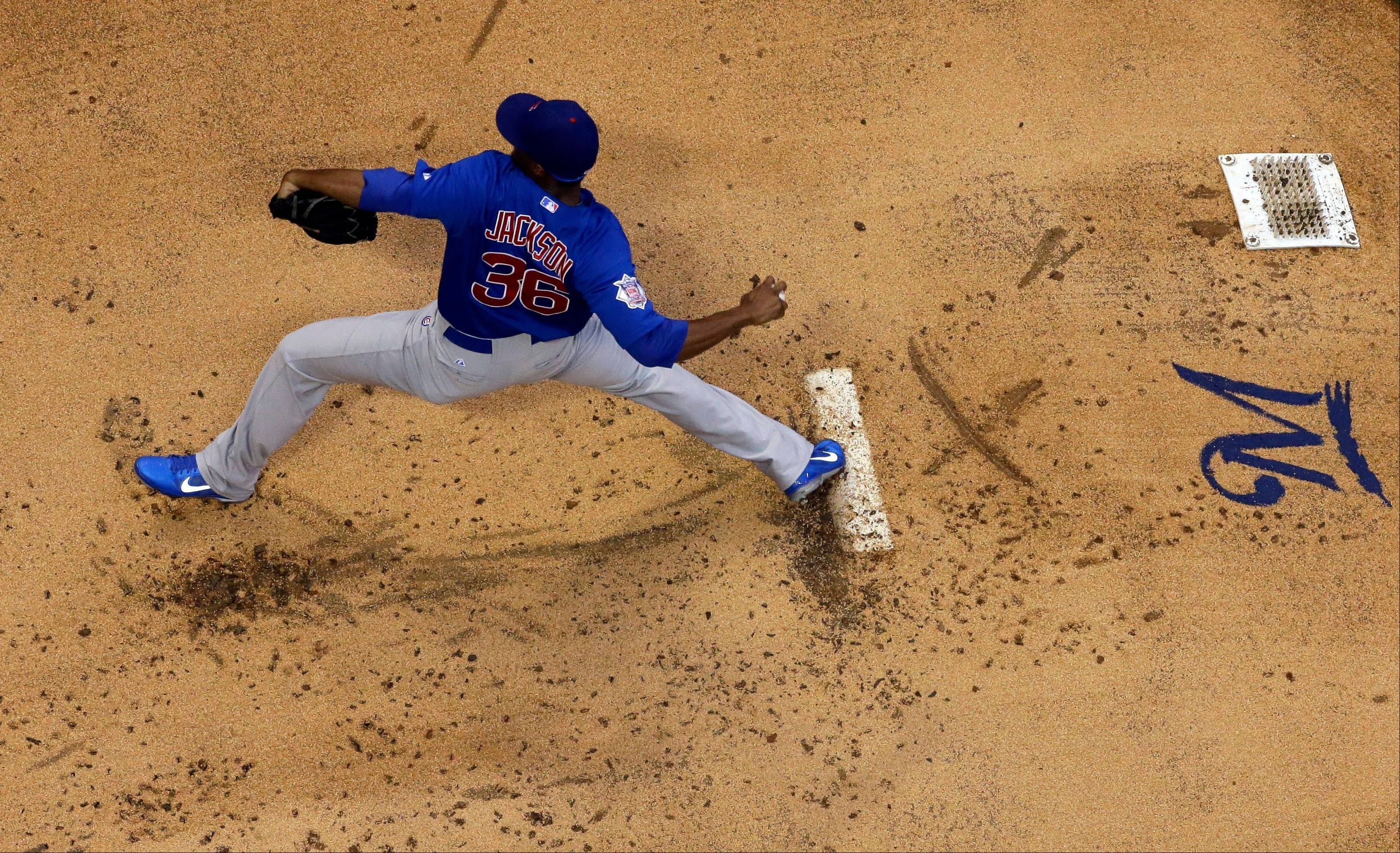 Chicago Cubs starting pitcher Edwin Jackson throws during the first inning of a baseball game against the Milwaukee Brewers Tuesday, June 25, 2013, in Milwaukee. (AP Photo/Morry Gash)