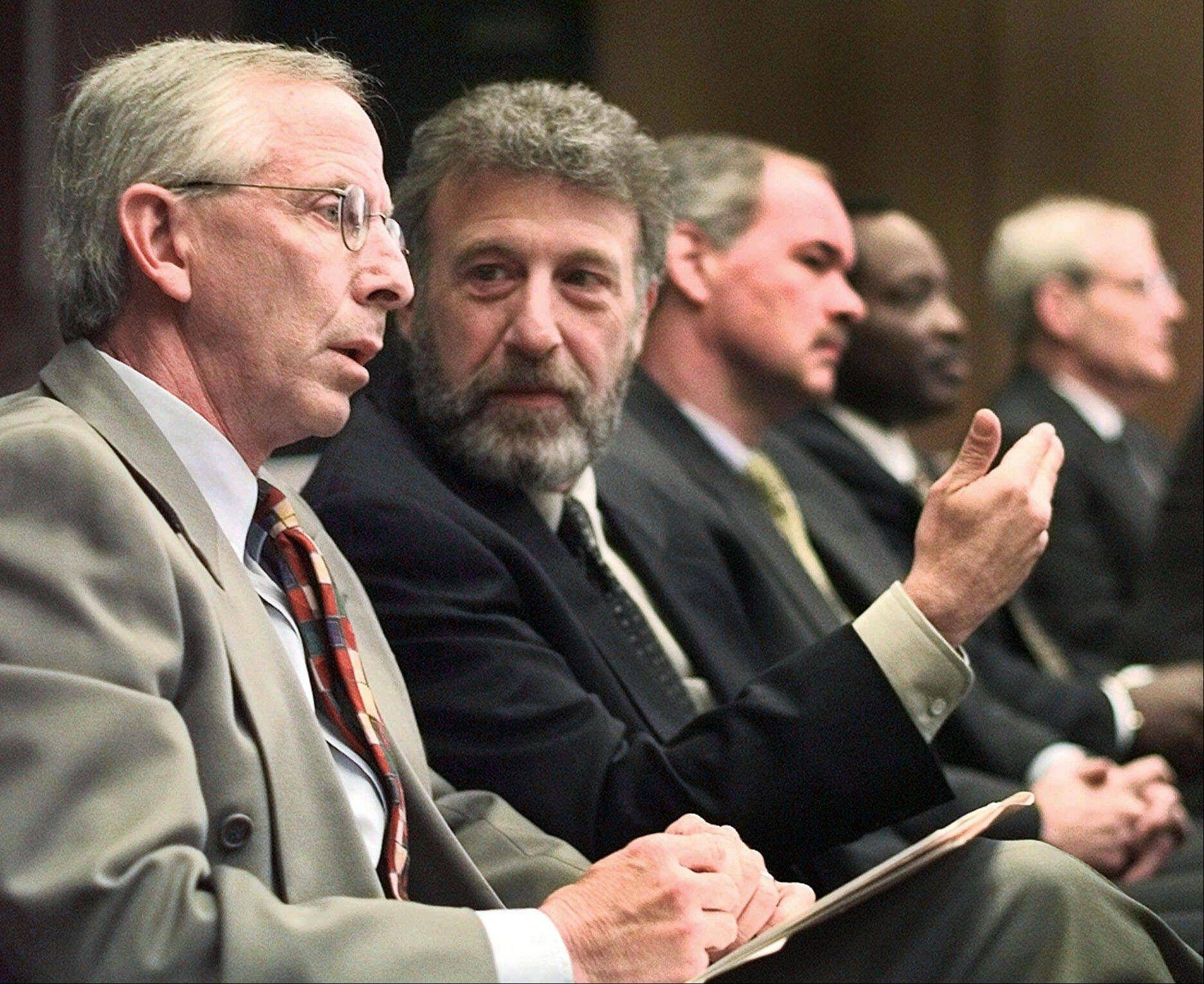 "Men's Wearhouse has offered some details on why it parted ways with its founder, George Zimmer, second from left, saying he seemed to have difficulty ""accepting the fact that Men's Wearhouse is a public company with an independent board of directors and that he has not been the chief executive officer for two years."""