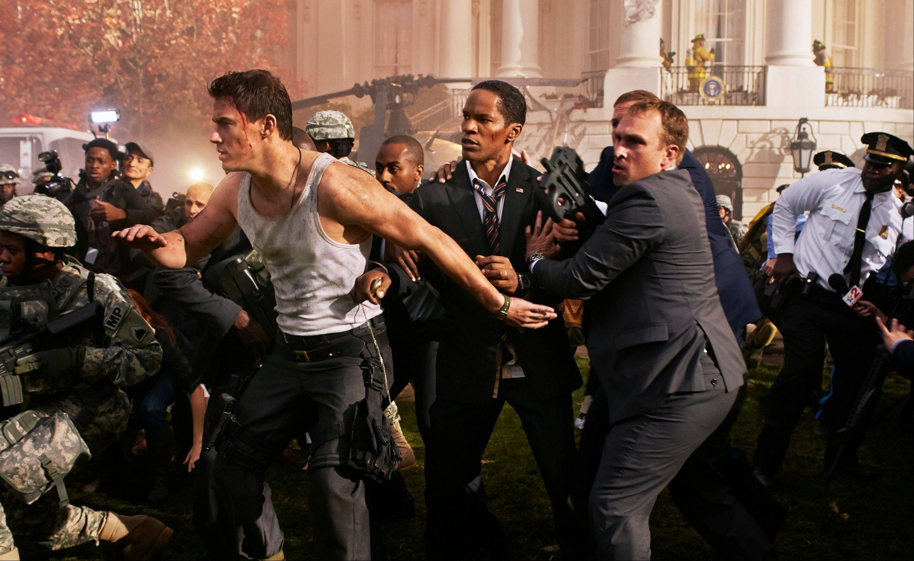 "Channing Tatum, left, and Jamie Foxx, center, star in Columbia Pictures' ""White House Down."""