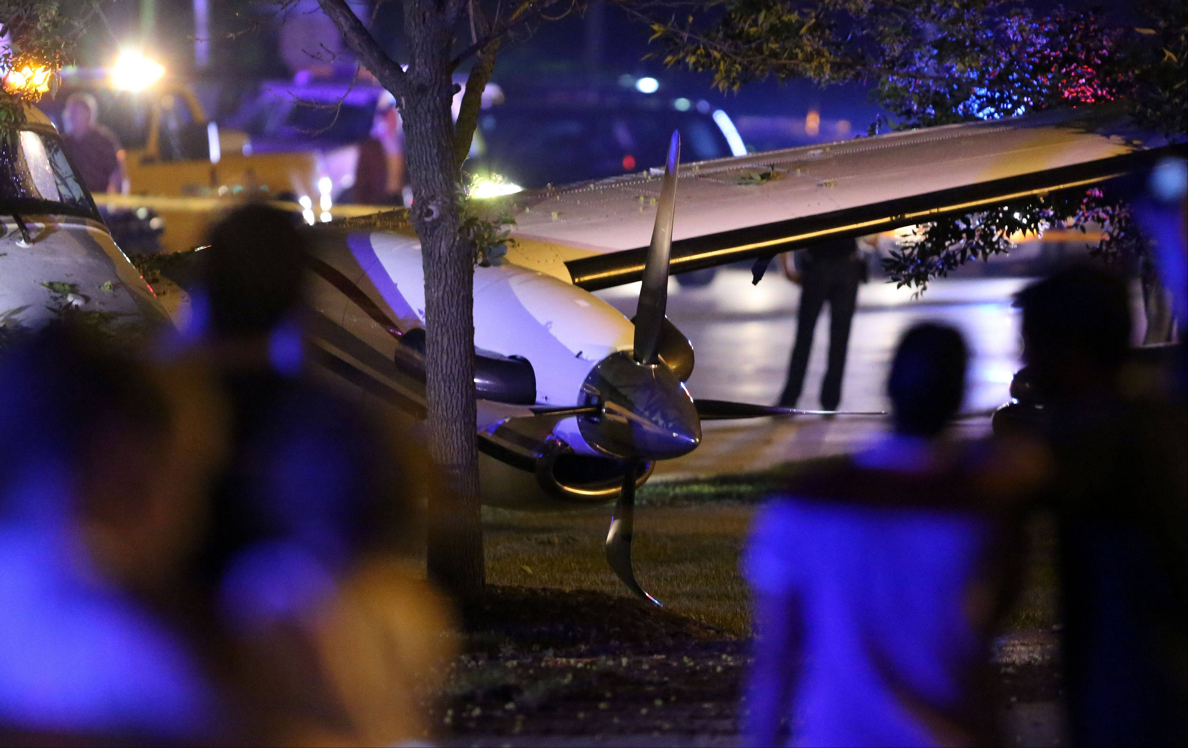 A plane sits on Wolf Road in Wheeling after it crashed Tuesday near the Foxboro Apartments.