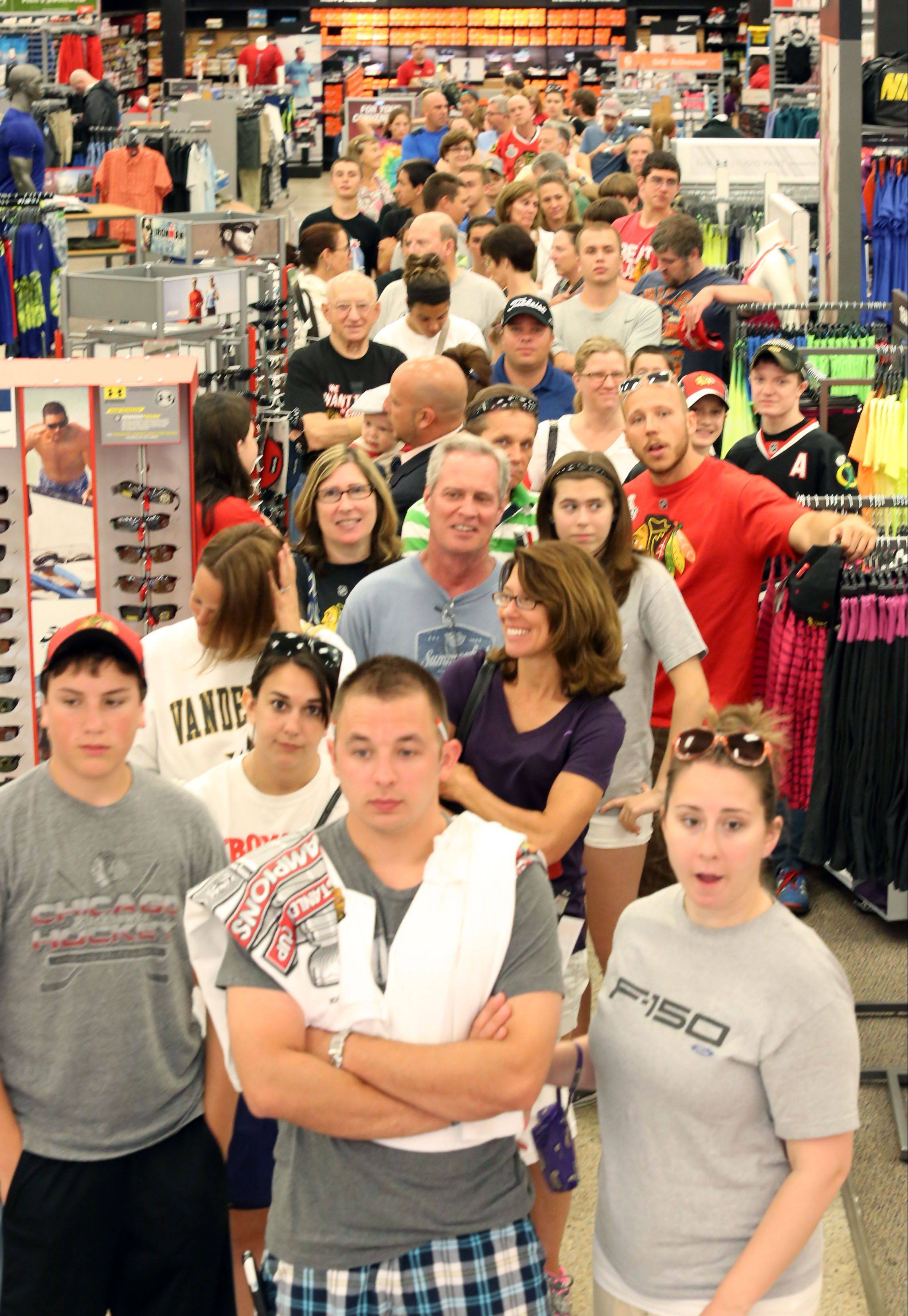 About 120 shoppers stood in line for hours to purchase official Chicago Blackhawks Stanley Cup hats at Sports Authority at Randhurst Village in Mount Prospect on Tuesday. The store brought in more supplies after selling out quickly.