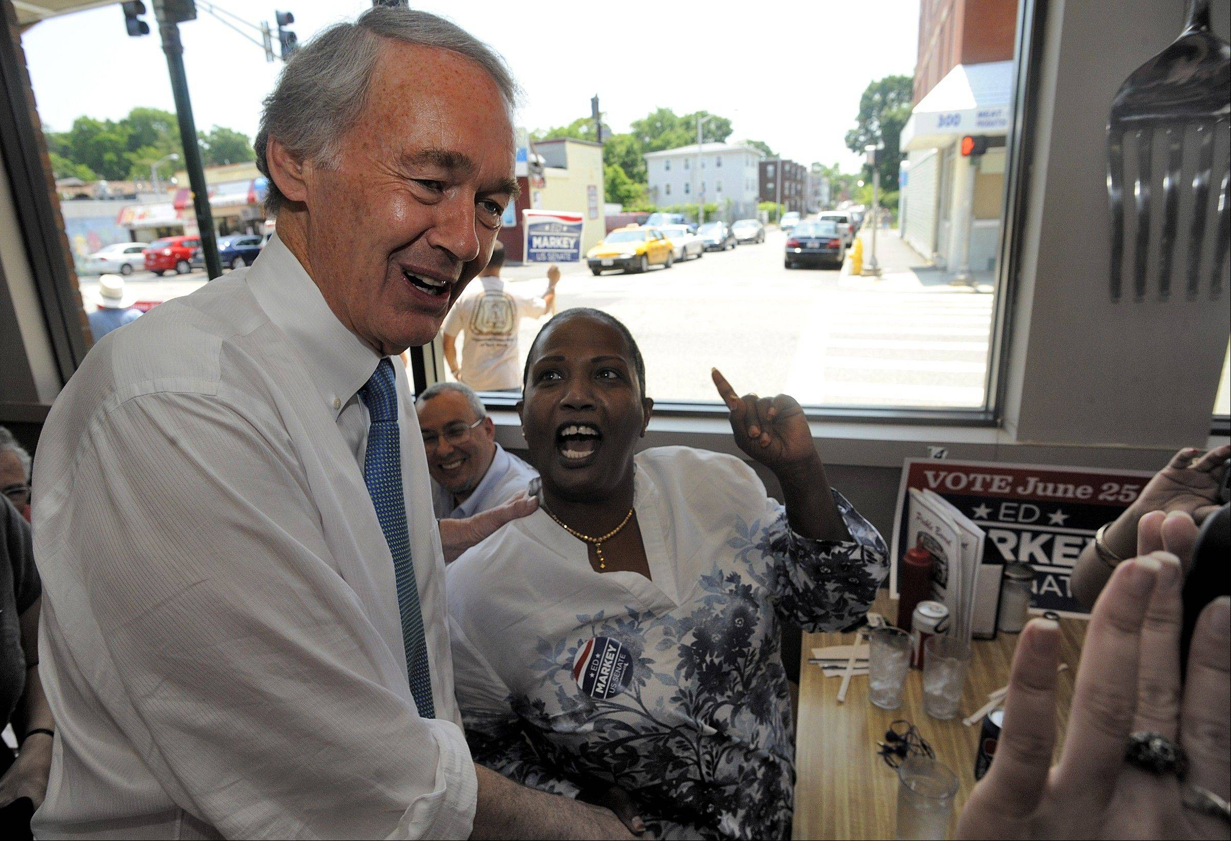 Massachusetts Senate Democratic candidate Ed Markey, left, meets and greets grass-roots volunteers and supporters Monday in the final hours before Massachusetts' special election for the U.S. Senate, where turnout is expected to be light, a contrast to the high-profile special election in the state three years ago.