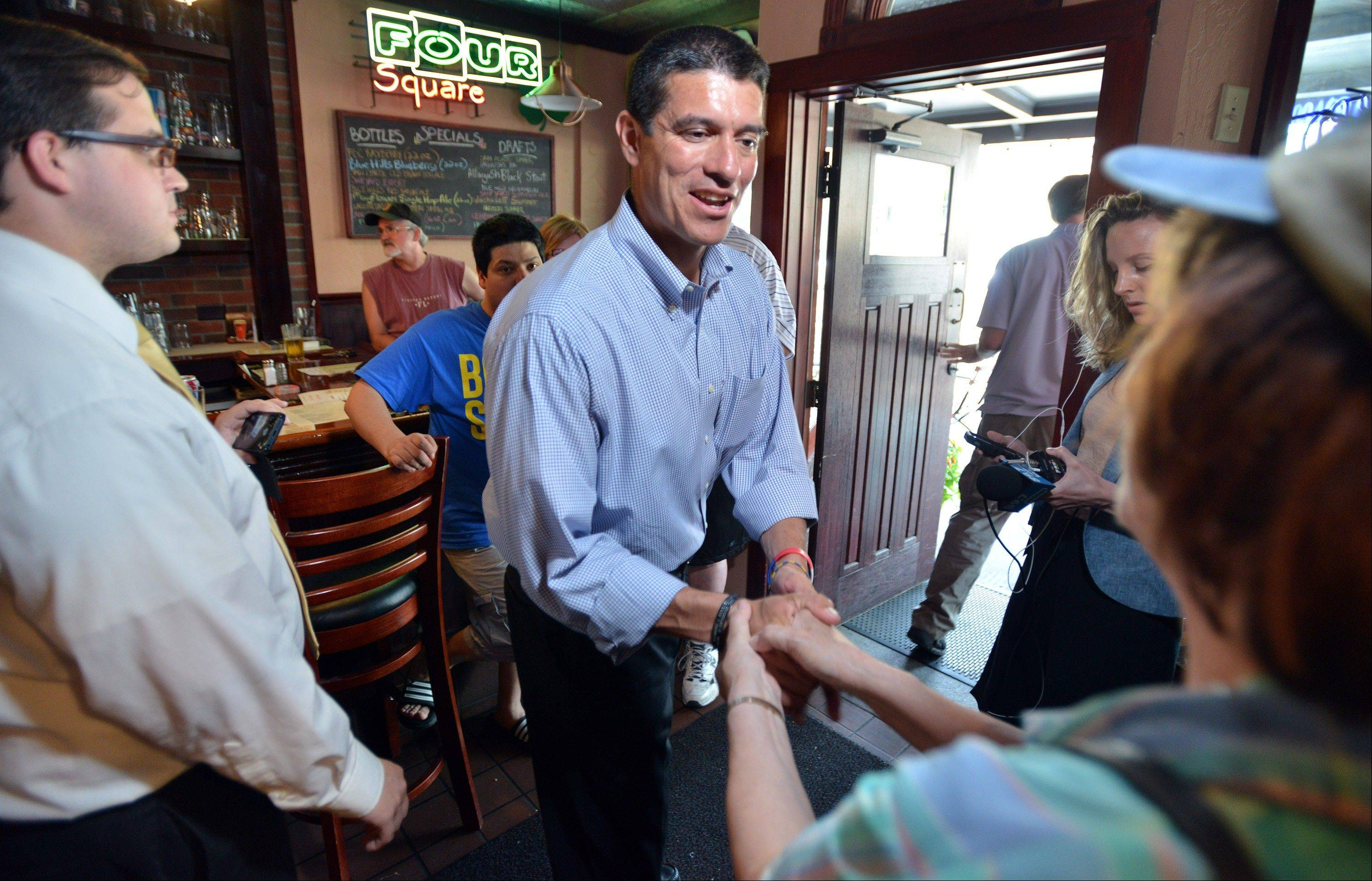 Gabriel Gomez, Republican candidate for U.S. Senate in the Massachusetts open seat special election, greets supporters, Monday, June 24, 2013, at the Four Square restaurant in Braintree, Mass. Gomez faces Democrat Rep. Ed Markey in Tuesday's election.