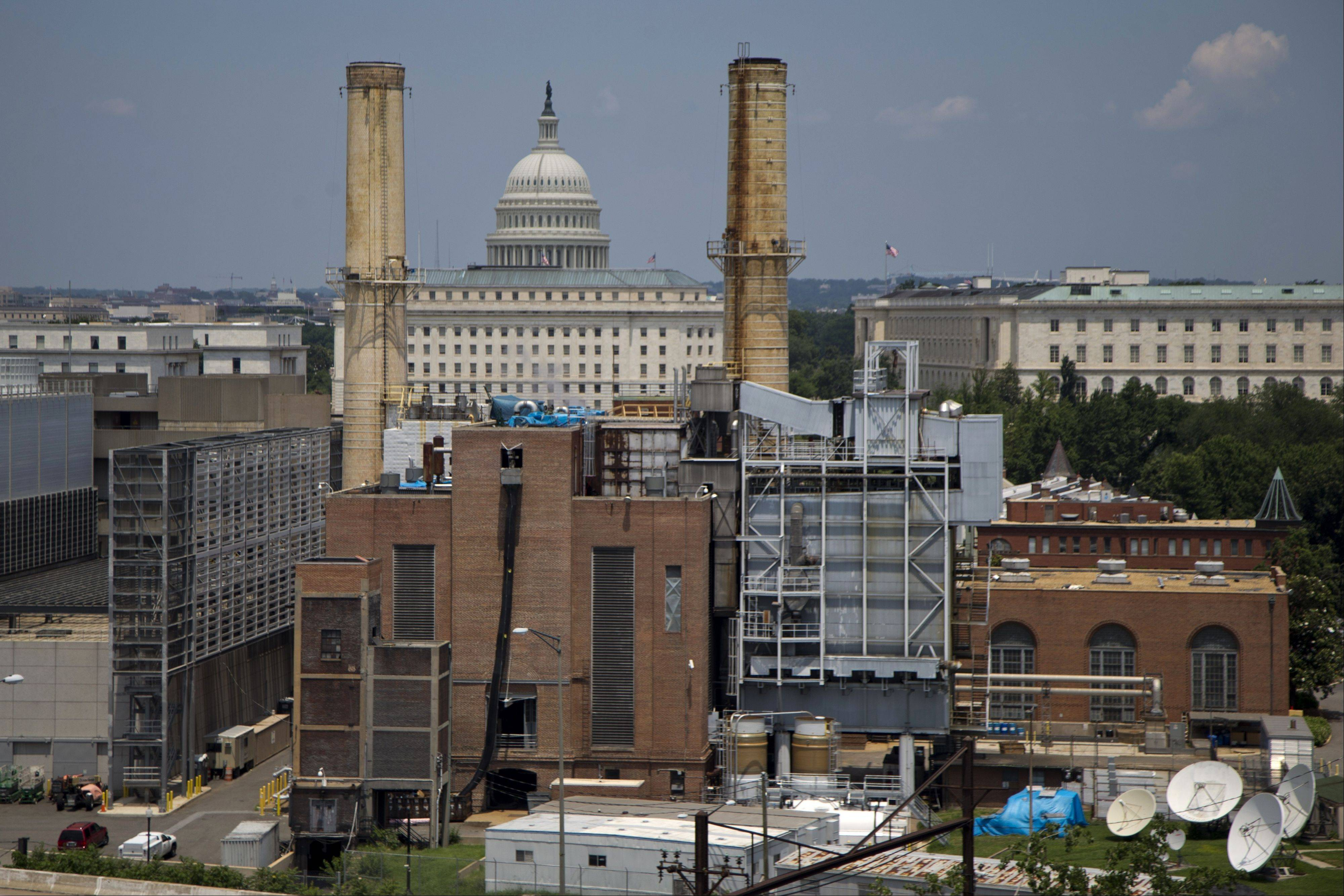 The Capitol Dome is seen behind the Capitol Power Plant in Washington Monday. The plant provides power to buildings in the Capitol Complex. President Barack Obama is running out of time to make good on his lofty vow to confront climate change head-on, and Congress is in no mood to help.