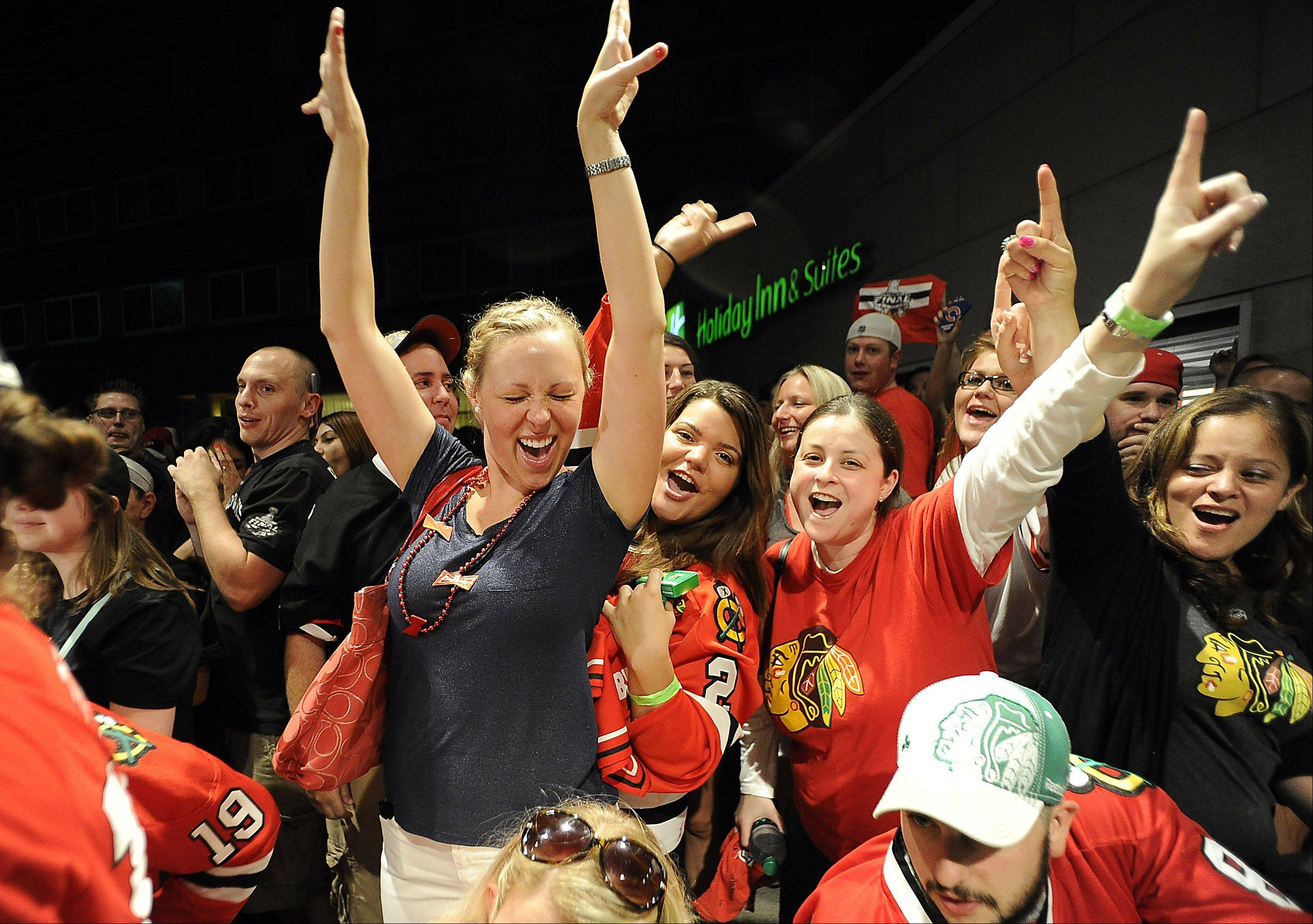 Dani Weadley, 26, of Fox Lake cheers with more than a thousand of her fellow Blackhawks fans at Harry Caray's restaurant in Rosemont as the players arrive carrying the Stanley Cup.