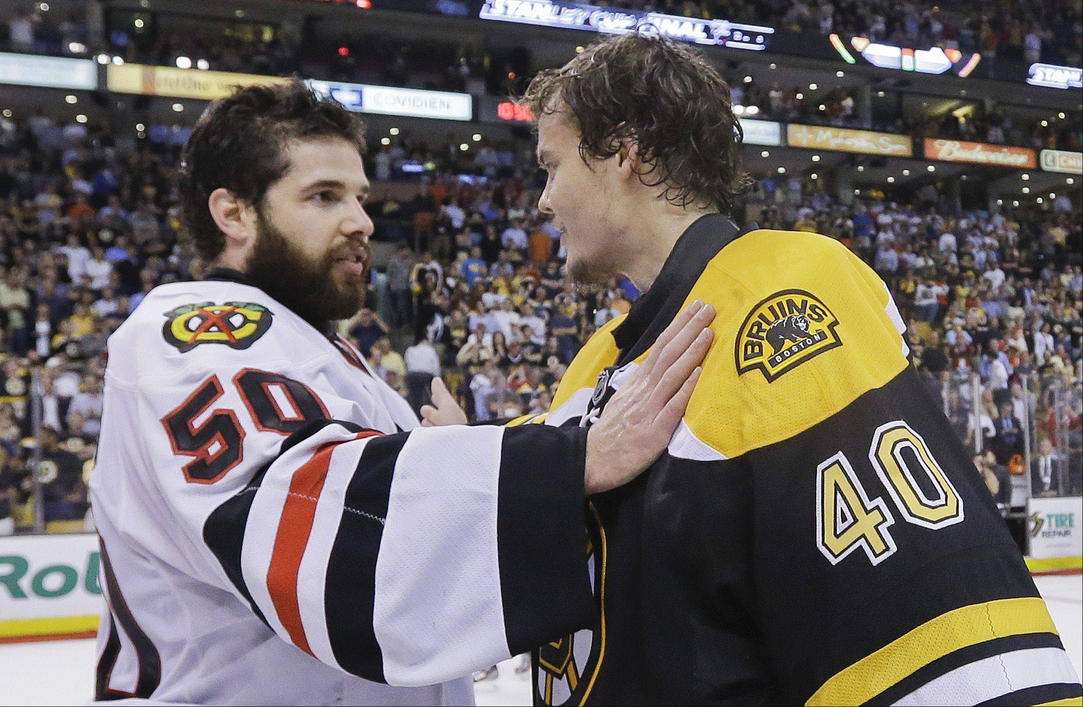 Chicago Blackhawks goalie Corey Crawford (50) is congratulated by Boston Bruins goalie Tuukka Rask (40), of Finland, after the Blackhawks beat the Boston Bruins in the Stanley Cup Finals Monday, June 24, 2013, in Boston.