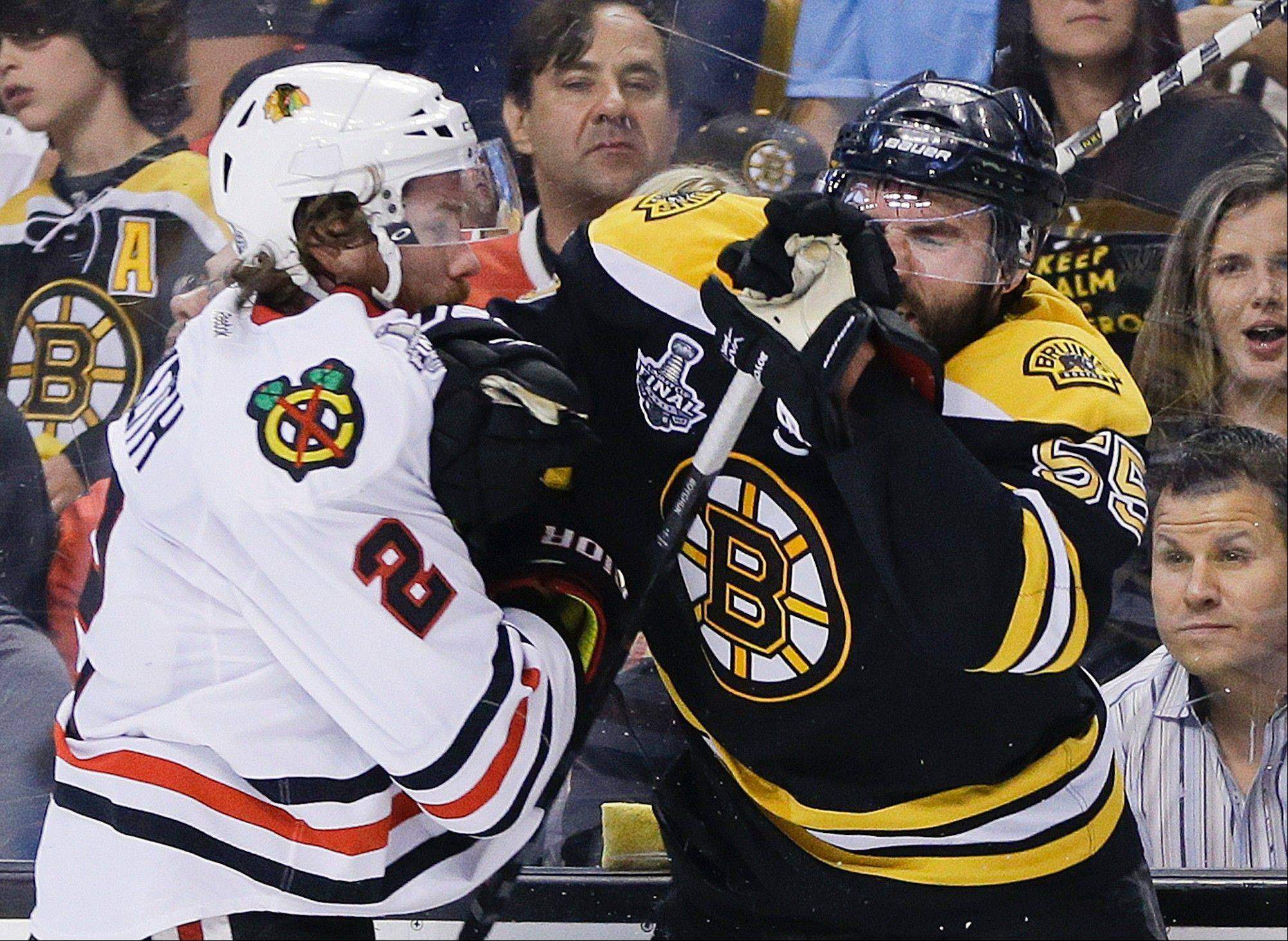 Chicago Blackhawks defenseman Duncan Keith (2) checks Boston Bruins defenseman Johnny Boychuk (55) during the first period in Game 6 of the NHL Stanley Cup Finals Monday in Boston.