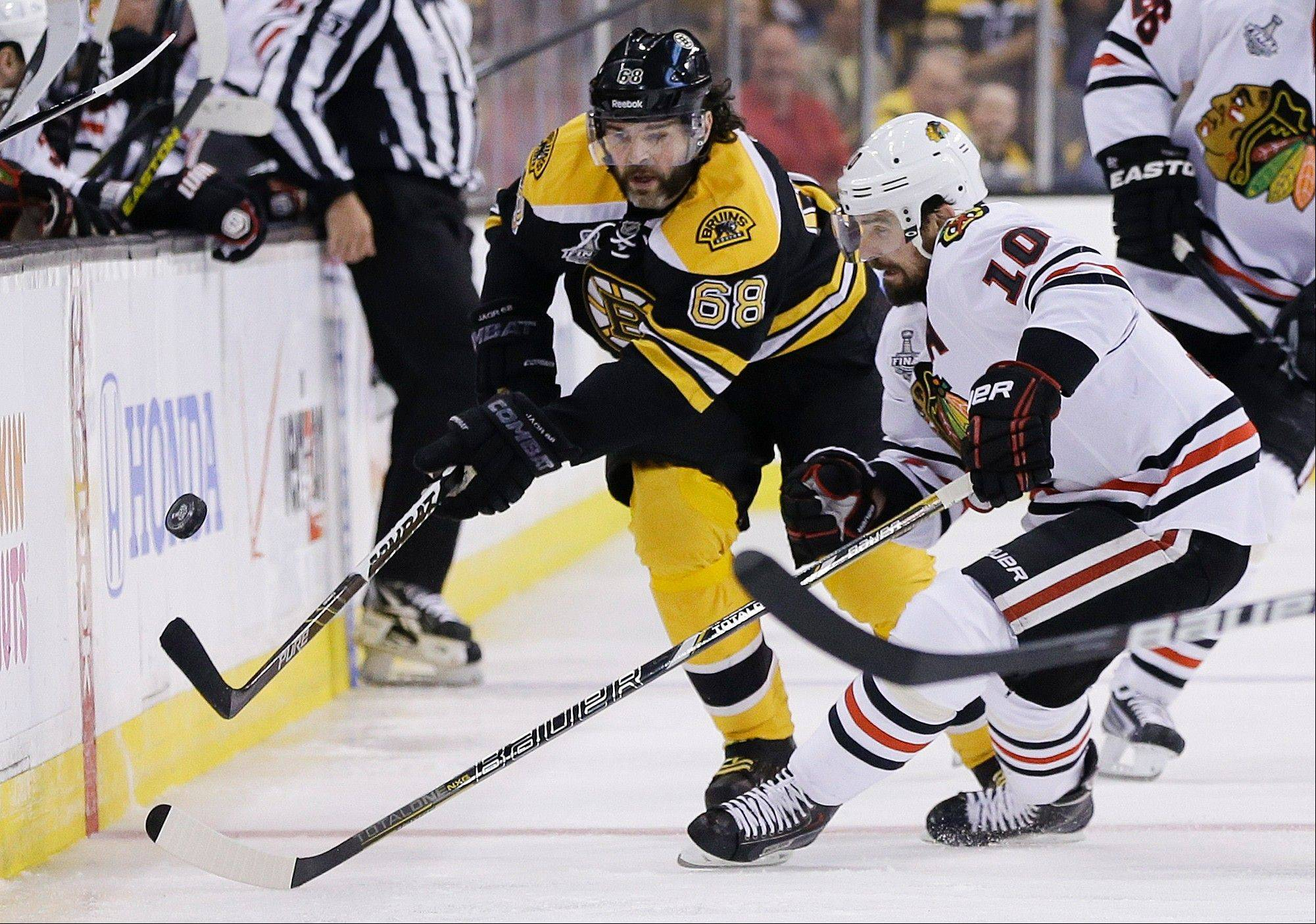 Chicago Blackhawks center Patrick Sharp (10) and Boston Bruins right wing Jaromir Jagr (68), of the Czech Republic, pursue the puck during the first period in Game 6 of the NHL hockey Stanley Cup Finals Monday, June 24, 2013 in Boston.