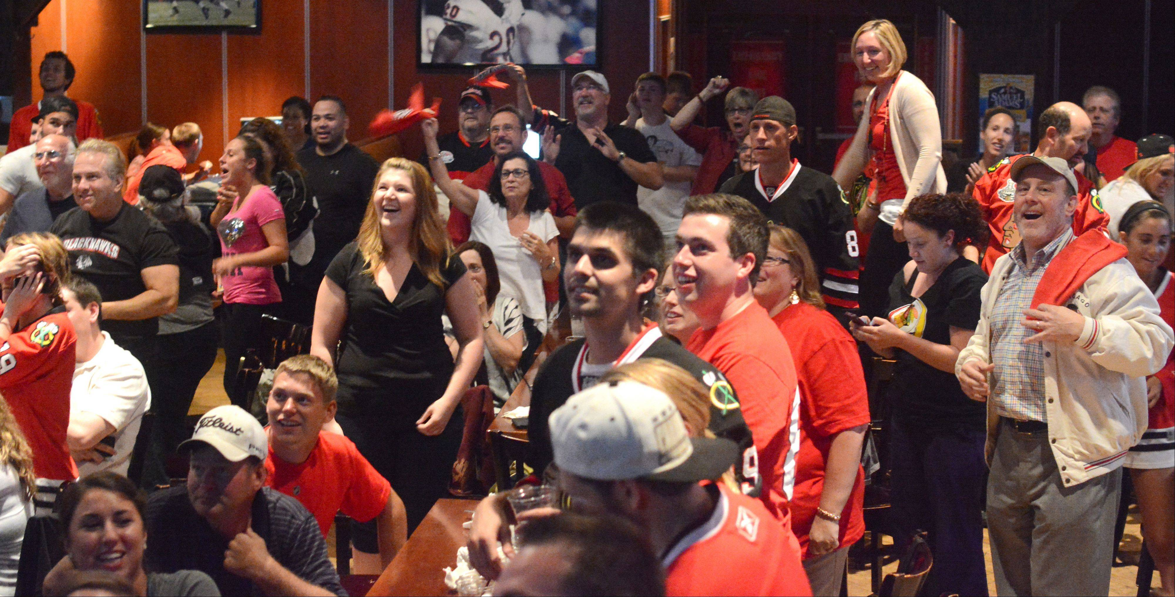 Patrons of The Cubby Bear North react as the Blackhawks win the Stanley Cup Monday.