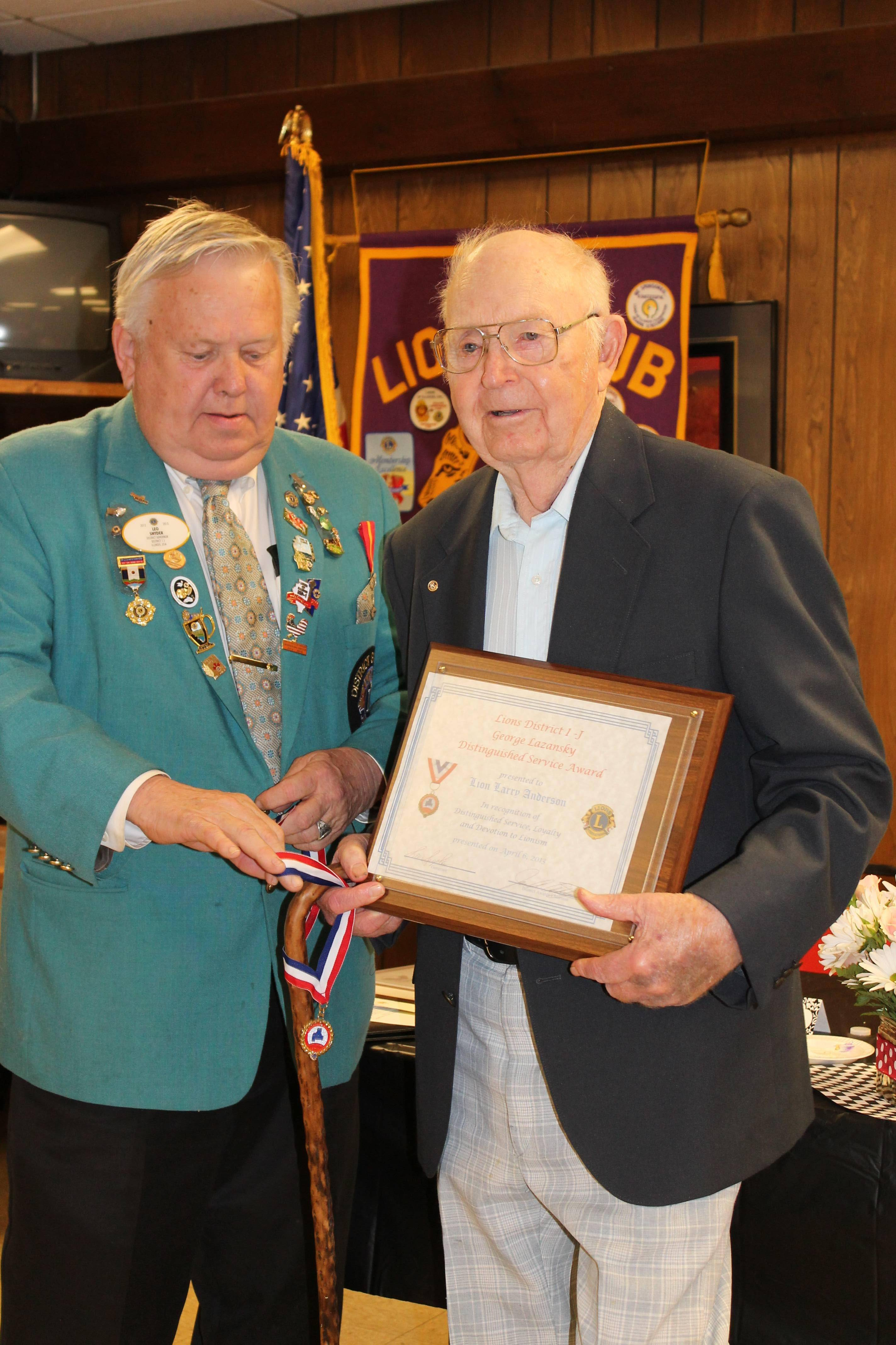 District 1J Governor Lion Leo Snyder presents Lion Larry Anderson with the Lazansky Award.