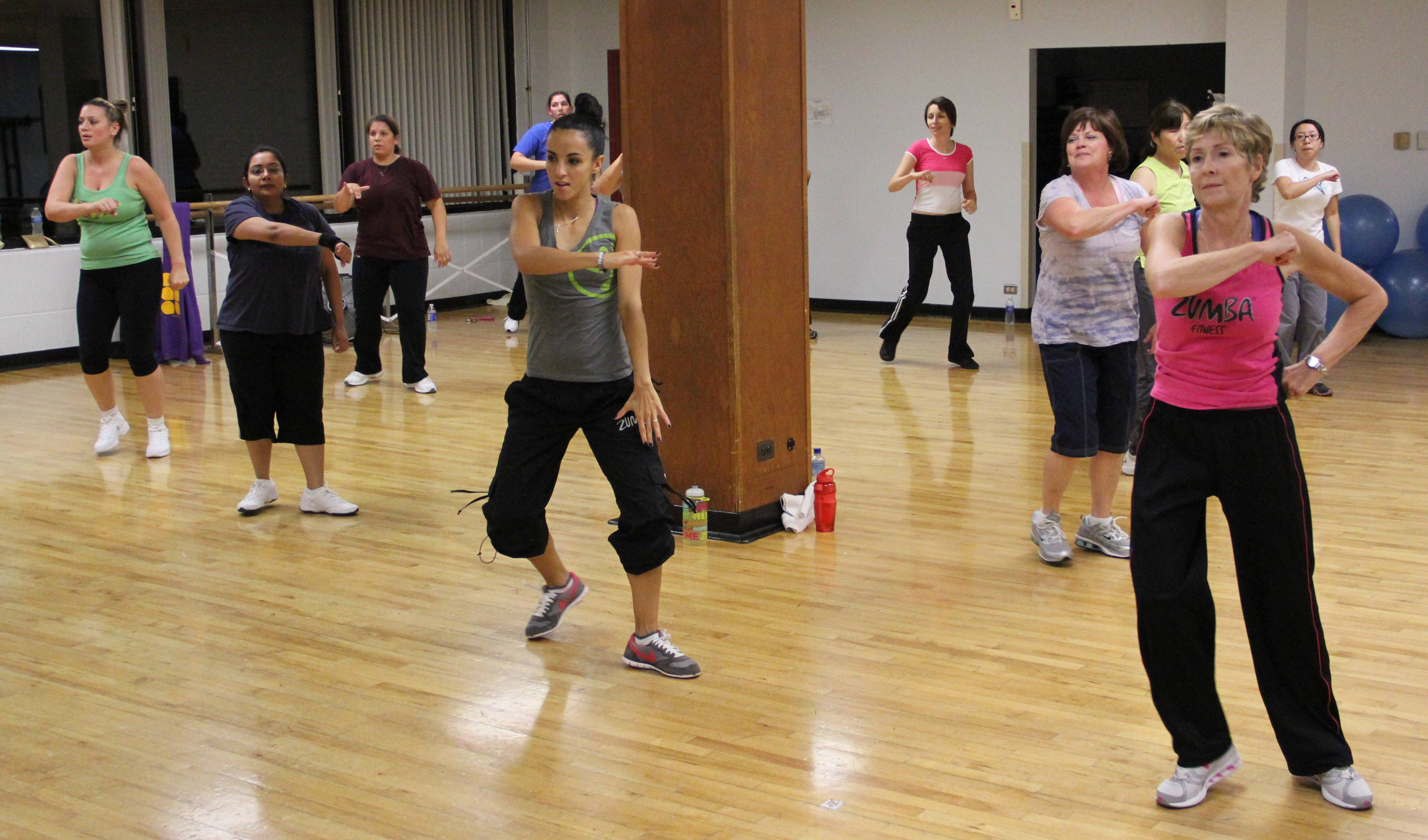 Participants dance in a ZUMBA class at the Community Recreation Center.