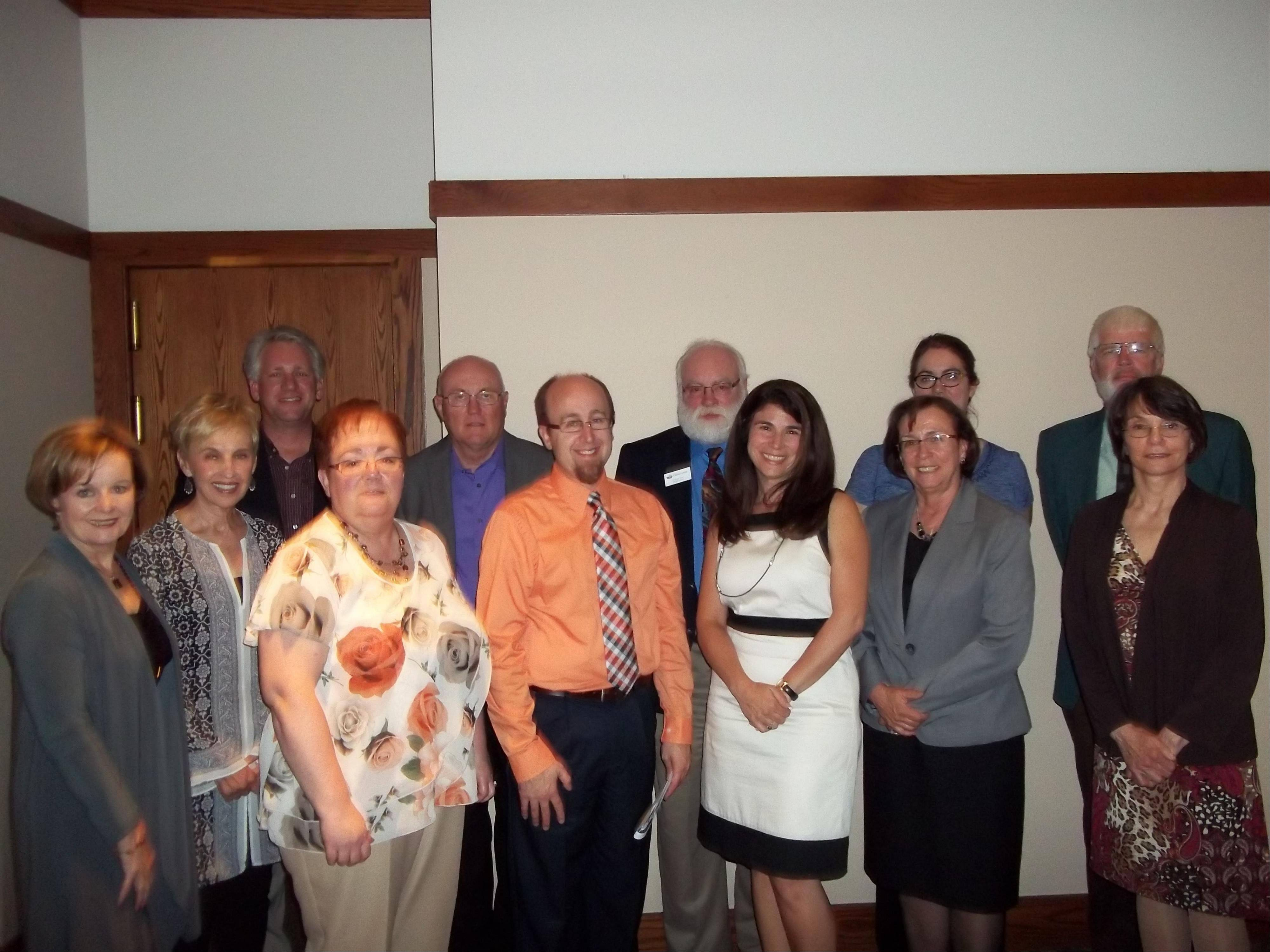 At its June meeting, the Elgin Cosmopolitan Club distributed $16,825 in grants to local organizations.