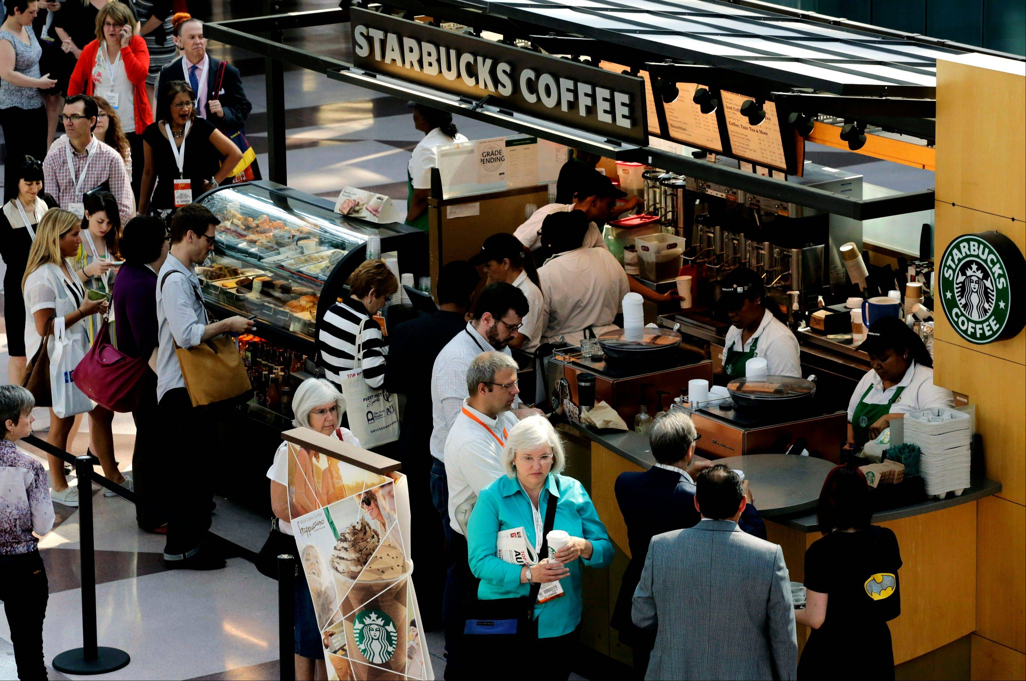 Associated Press/May 30, 2013, file photo Customers line up at a Starbucks Coffee in New York. Starbucks baristas must share their tips with shift supervisors, but assistant managers are left out in the cold, New York�s highest court ruled Wednesday.