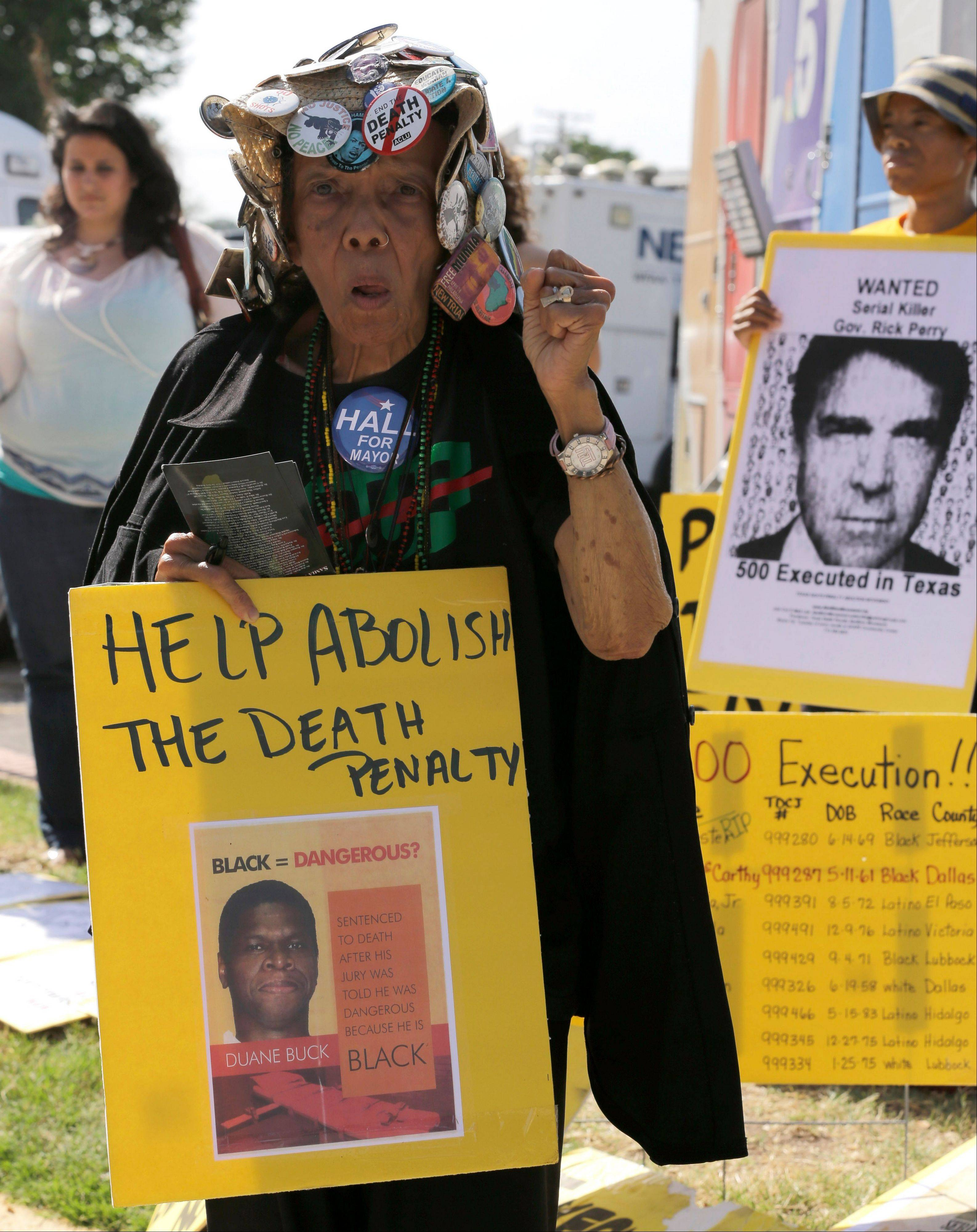 Jean Wilkins Dember, 83, joins others Wednesday as they protest the 500th execution in Texas outside the Texas Department of Criminal Justice Huntsville Unit, where the death chamber is located.