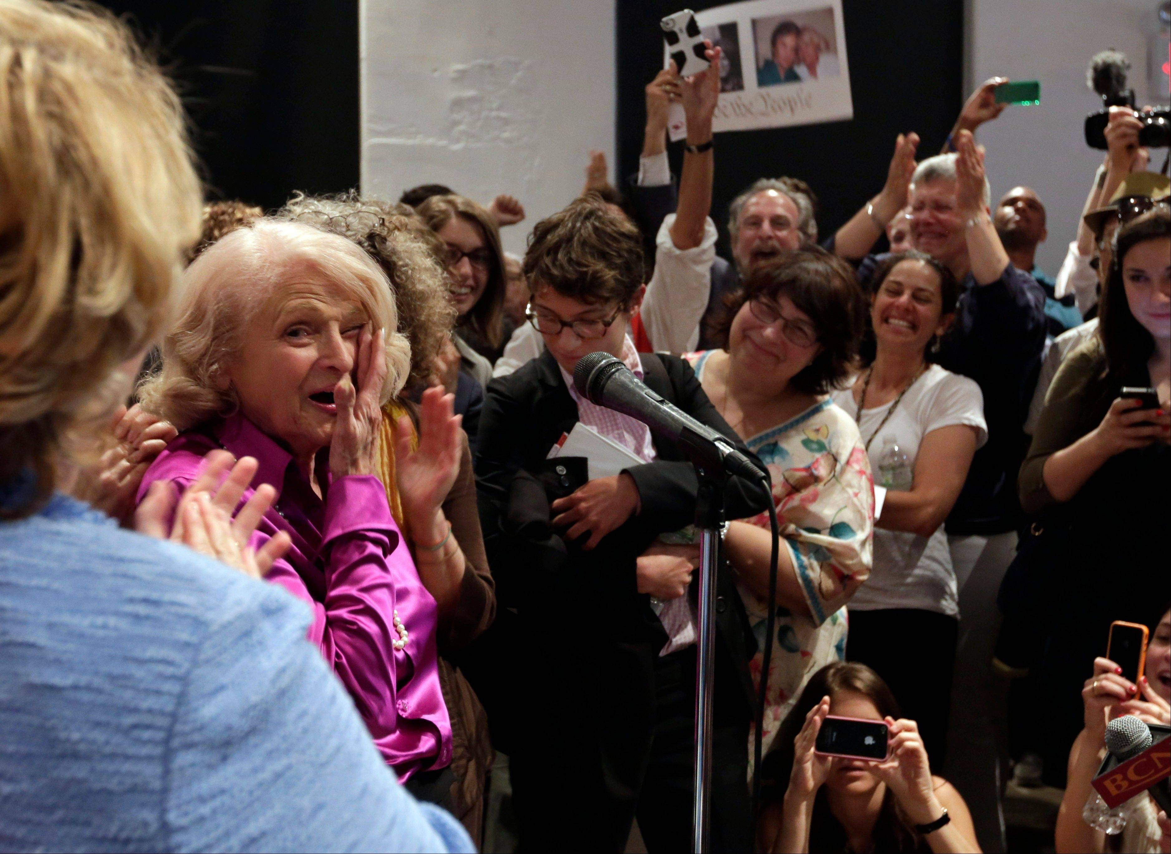 Edith Windsor, left, the plaintiff in the historic gay marriage case that was before the U.S. Supreme Court, wipes her eyes Wednesday after addressing supporters at the LGBT Center, in New York.