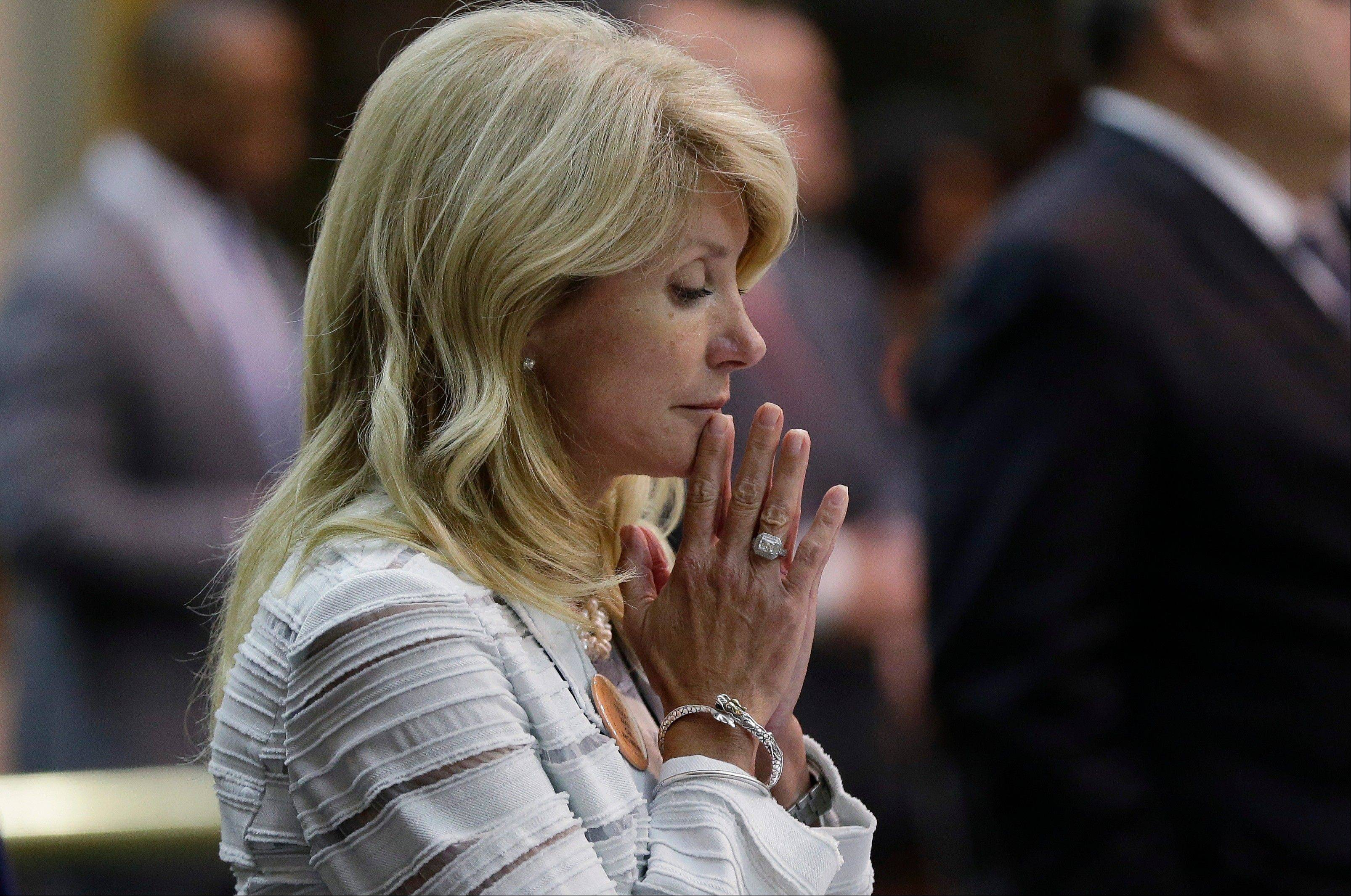 Sen. Wendy Davis, D-Fort Worth, reacts after she was called for a third and final violation in rules to end her filibuster attempt to kill an abortion bill, Tuesday, June 25, 2013, in Austin, Texas. The bill would ban abortion after 20 weeks of pregnancy and force many clinics that perform the procedure to upgrade their facilities and be classified as ambulatory surgical centers. (AP Photo/Eric Gay)
