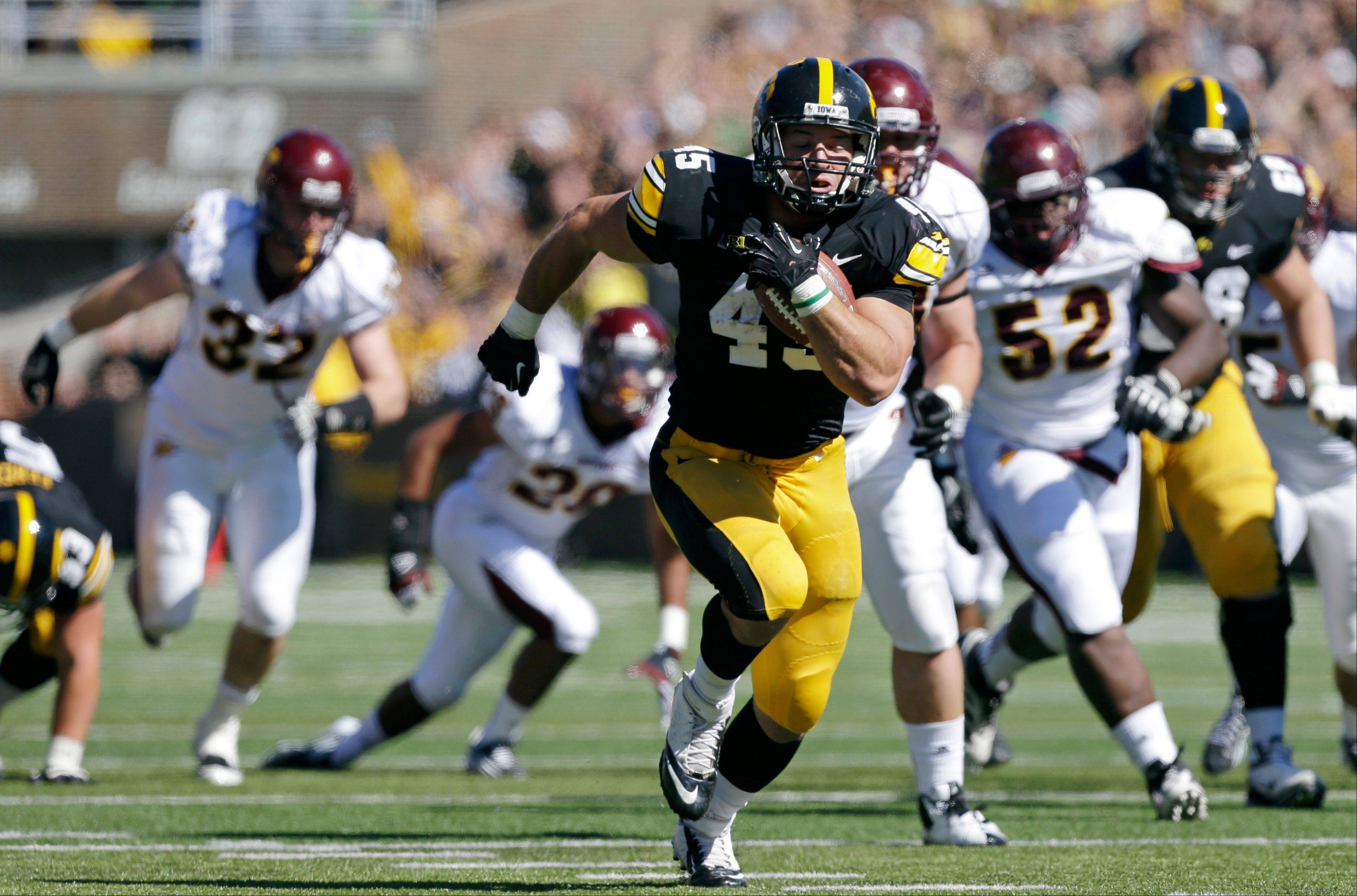 FILE - In this Sept. 22, 2012 file photo, Iowa fullback Mark Weisman runs for a 34-yard touchdown run during the first half of an NCAA college football game against Central Michigan, in Iowa City, Iowa. One of the few bright spots for Iowa last season was the emergence of Weisman, a former walk-on fullback who showed he could be among the Big Ten's best ball carriers _ when healthy. (AP Photo/Charlie Neibergall, File)