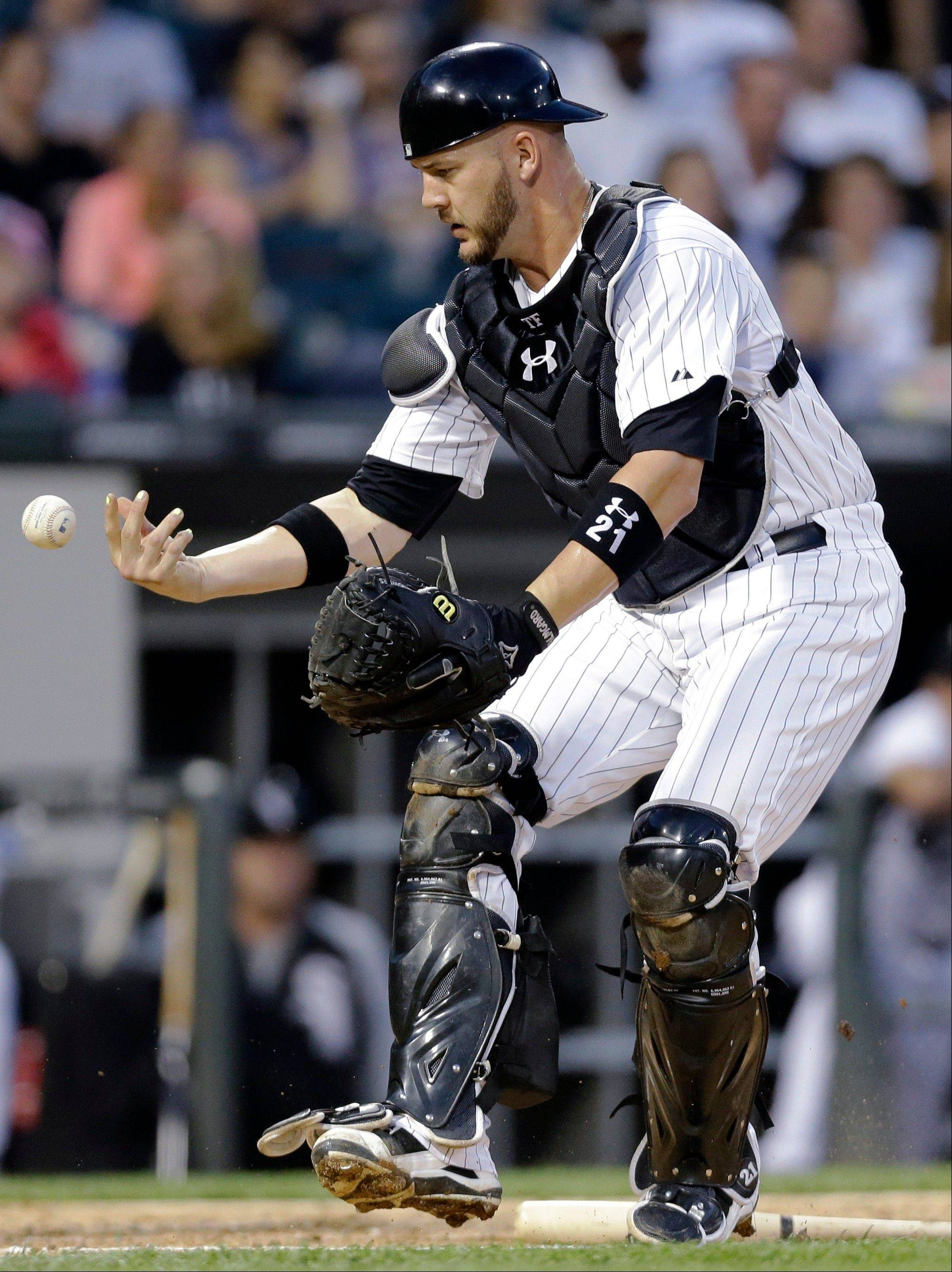 White Sox catcher Tyler Flowers can't make the play on a foul hit by New York Mets' Omar Quintanilla during the fifth inning of an interleague baseball game Wednesday, June 26, 2013, in Chicago. Quintanilla grounded out on the at-bat. (AP Photo/Nam Y. Huh)