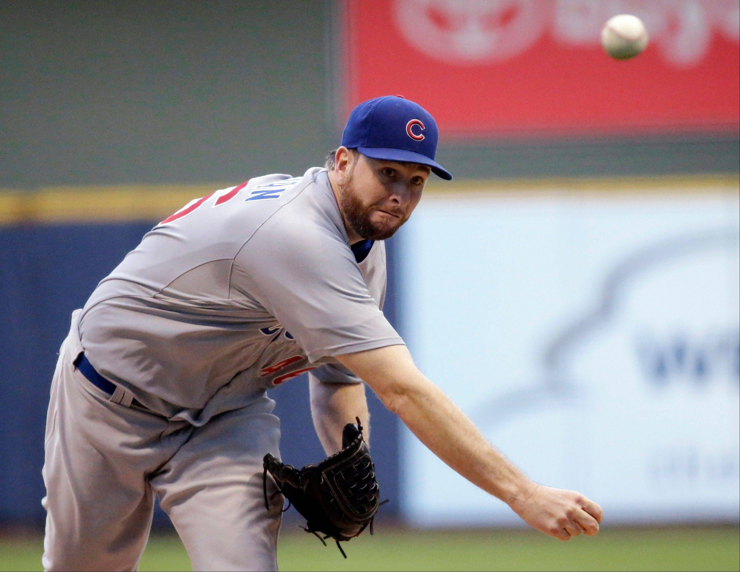 Chicago Cubs starting pitcher Scott Feldman throws during the first inning of a baseball game against the Milwaukee Brewers on Wednesday, June 26, 2013, in Milwaukee. (AP Photo/Morry Gash)