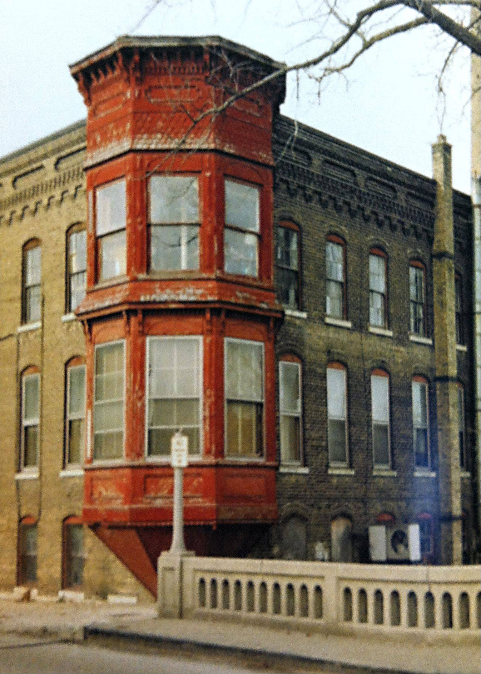 "OTTO Engineering's building at 10 W. Main St., as shown in ""The Historic Business District of Carpentersville"" before the family that owns OTTO renovated the three-story structure. The building has been standing since the 1800s and was in serious disrepair when the Roeser family bought it in 2005. During the restoration, 240 Dumpsters of junk were removed, according to the book."
