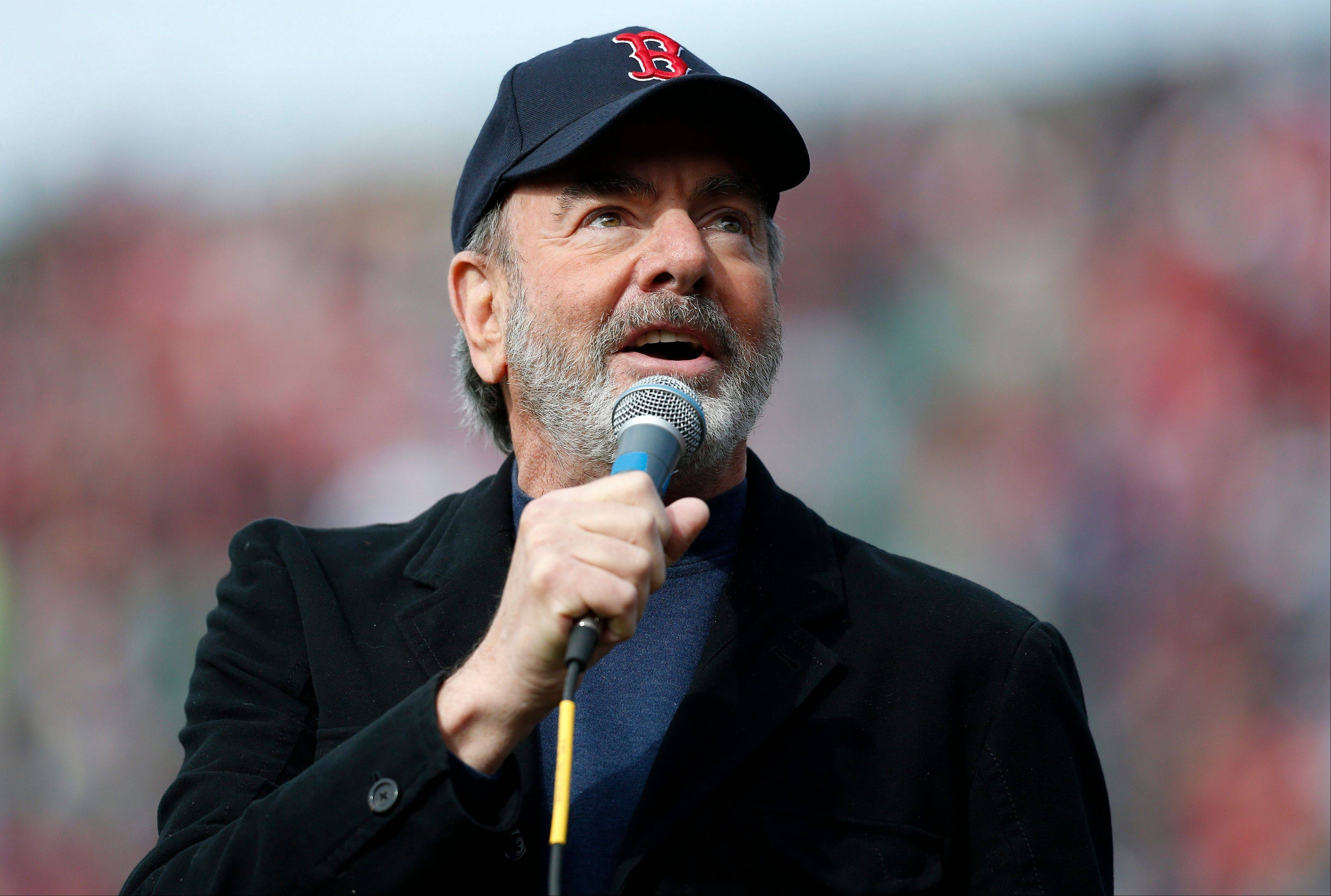 "Neil Diamond sings ""Sweet Caroline"" during the first Boston Red Sox home game after the Boston Marathon explosions. ""The Freedom Song (They'll Never Take Us Down),"" is a new patriotically themed song Diamond will release through iTunes and Amazon on July 2. All proceeds from the song will go to benefit the Boston One Fund and The Wounded Warriors Project."