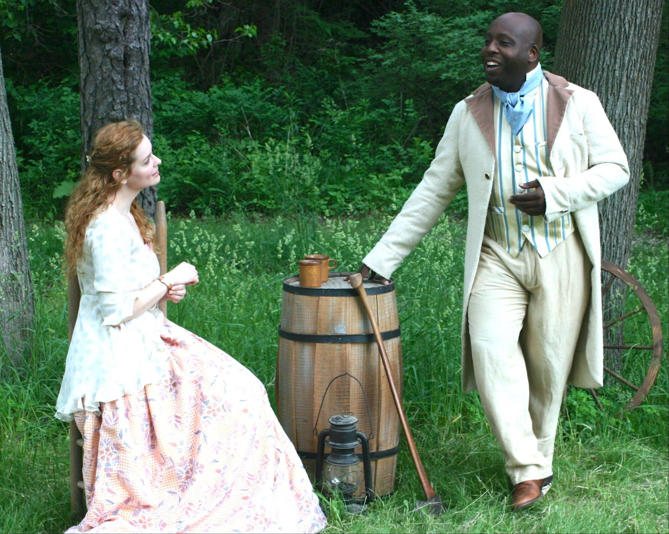 "Imogen (Kate McDermott) unsuspectingly welcomes Iachimo (James Earl Jones II), who has wagered that he can prove her to be an adultress, in First Folio Theatre's world premiere adaptation of ""Shakespeare's Cymbeline: A Folk Tale with Music"" at the Mayslake Peabody Estate in Oak Brook."