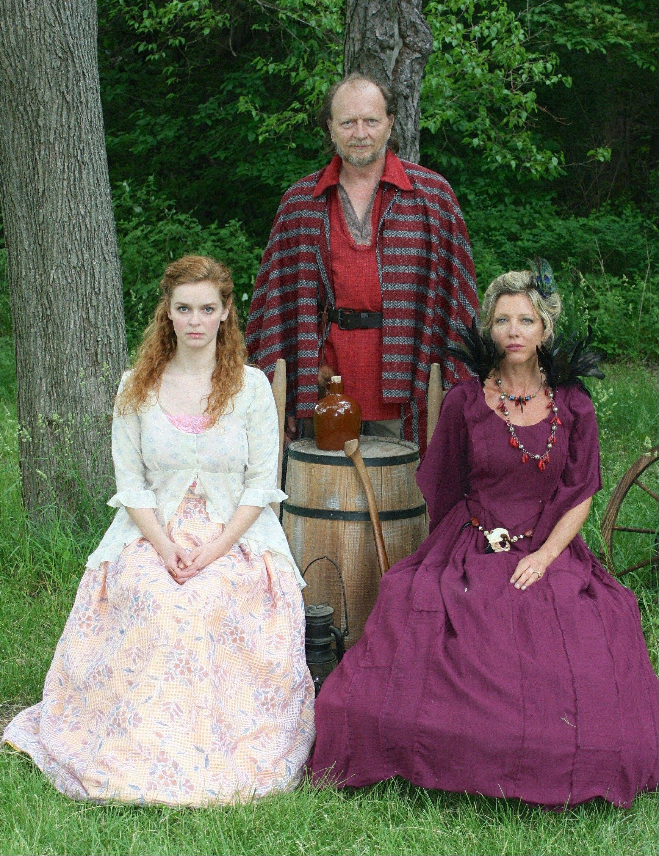 "Princess Imogen (Kate McDermott, left) has incurred the wrath of her father, King Cymbeline (John Milewski), and his Queen (Lia Mortensen) by marrying beneath her class in First Folio Theatre's world premiere adaptation of ""Shakespeare's Cymbeline: A Folk Tale with Music"" at the Mayslake Peabody Estate in Oak Brook."