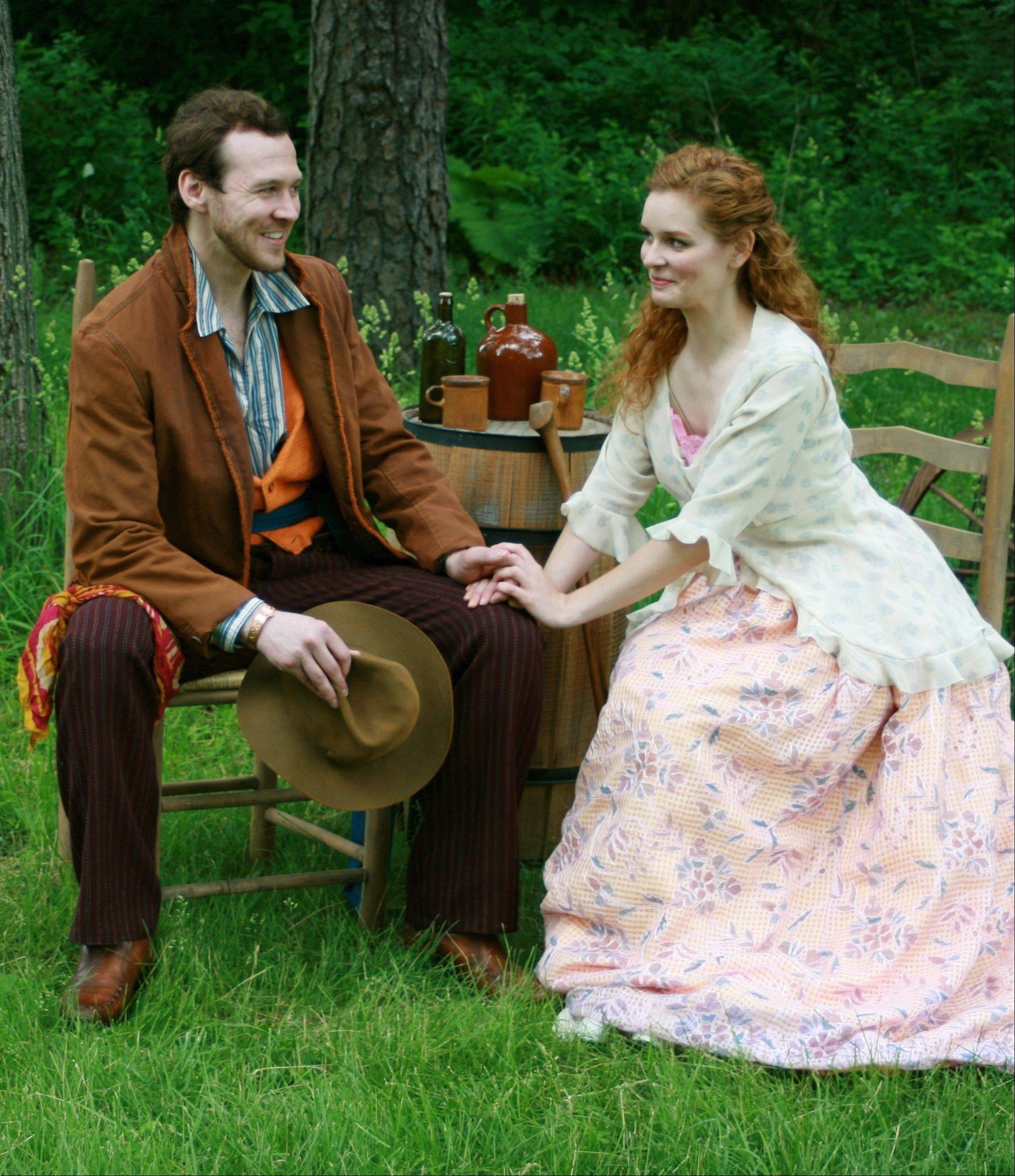 "Posthumus (Matthew Keffer) meets with his wife, Imogen (Kate McDermott), before he must flee in First Folio Theatre's ""Shakespeare's Cymbeline: A Folk Tale with Music"" at the Mayslake Peabody Estate in Oak Brook."