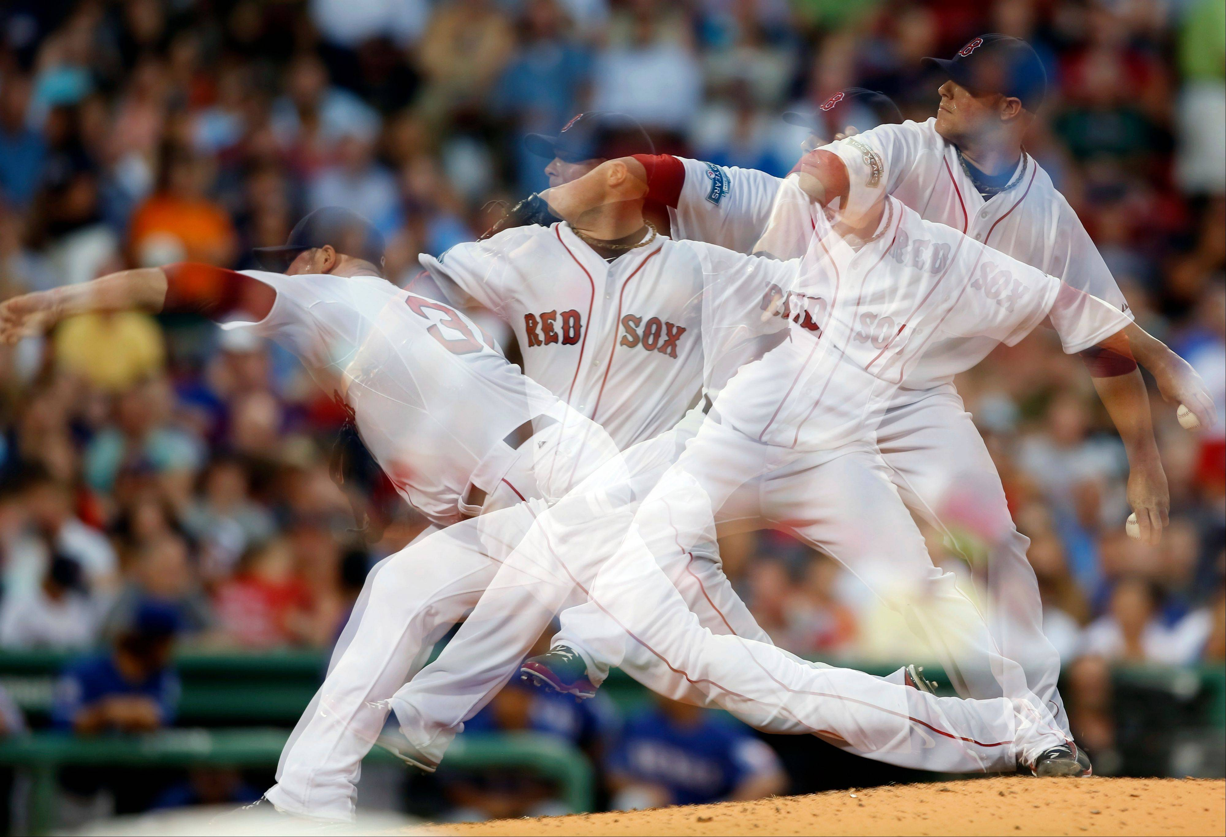 In photo made with a multiple exposure, Boston's Jon Lester pitches against Texas last season. A new study suggests the ability to throw hard and accurately first appeared in a human ancestor 2 million years ago.