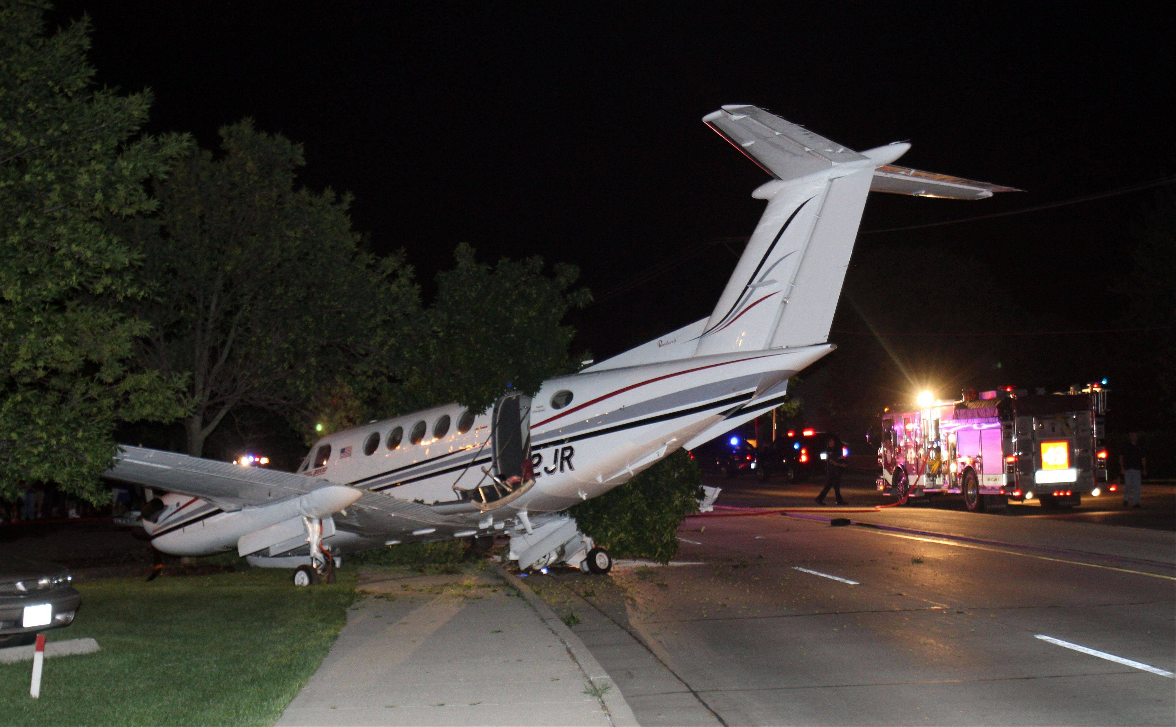 A plane sits on Wolf Road in Wheeling after it crashed near the Foxboro Apartments Tuesday night.