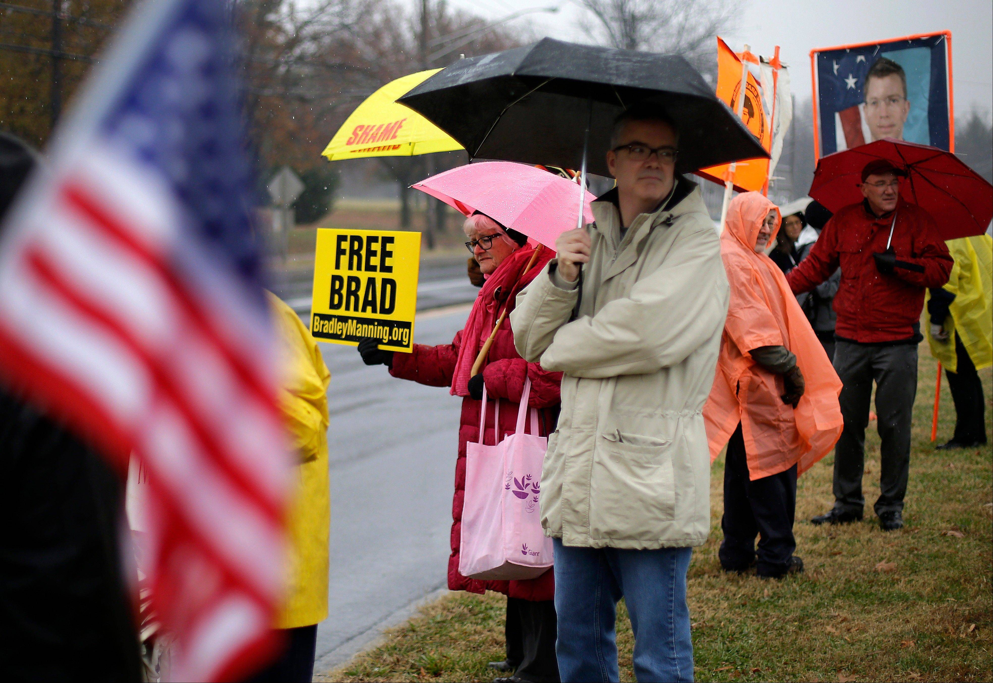 Demonstrators stand in support of Army Pfc. Bradley Manning outside of Fort Meade, Md., before a pretrial hearing.