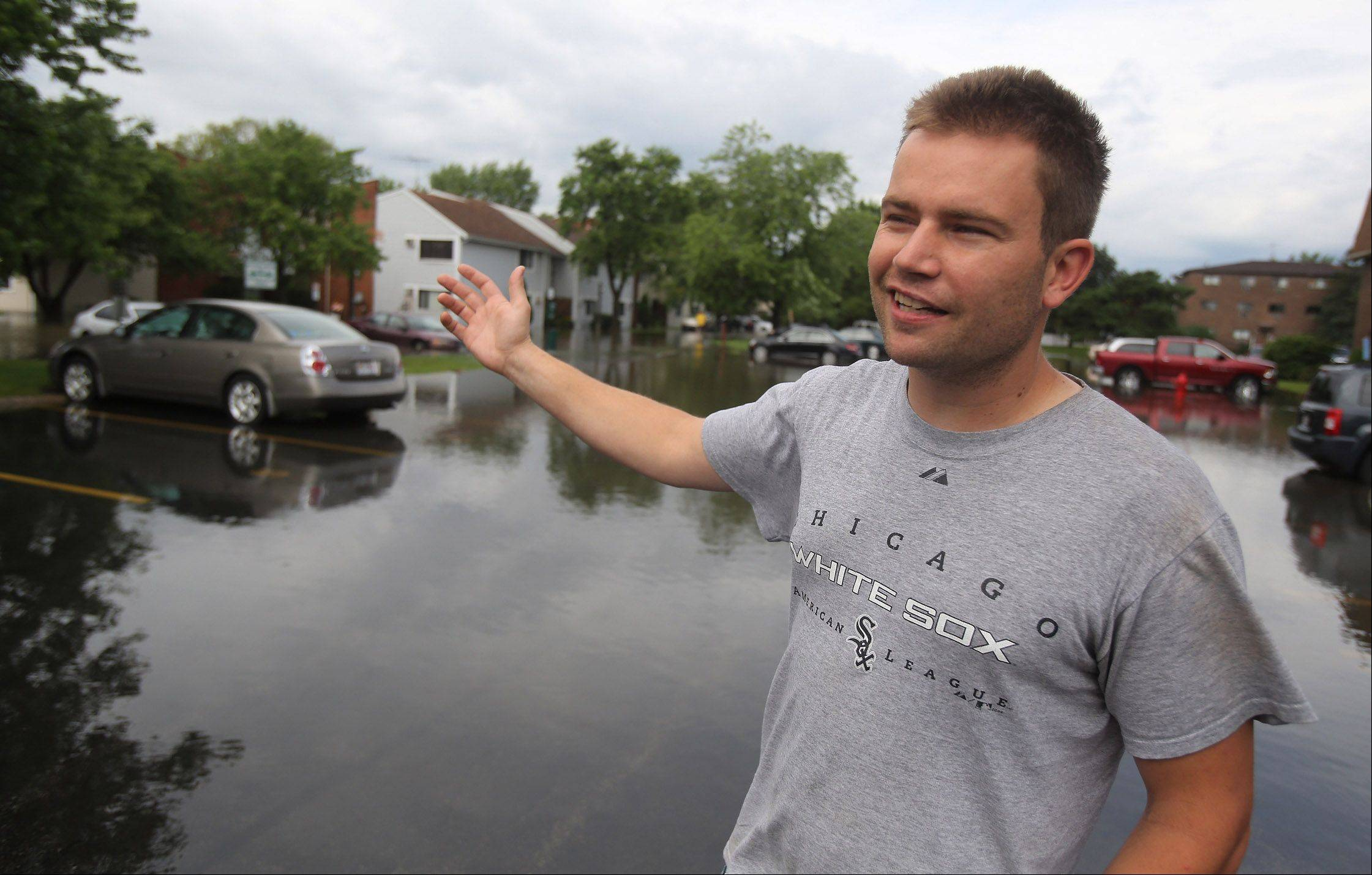 Greg Mandrek describes the damage to his cars and apartment after flooding at the Runaway Bay Apartments in Palatine on Wednesday.