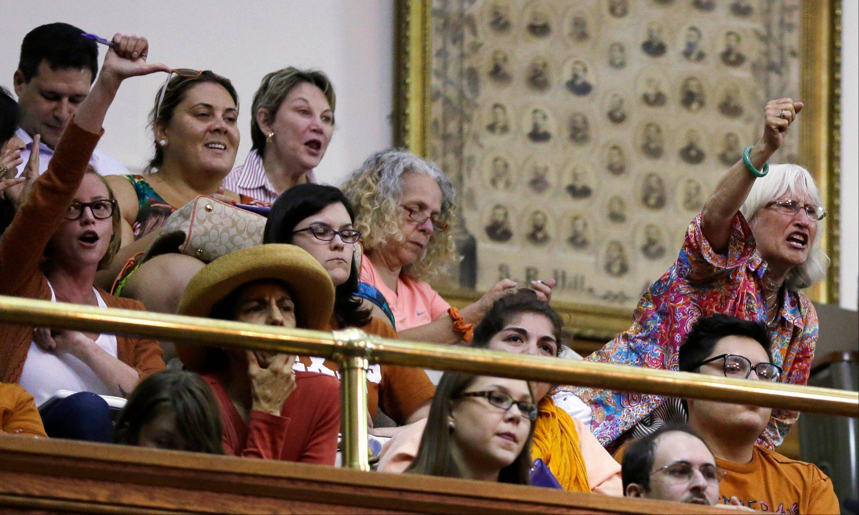Members of the gallery respond as Sen. Wendy Davis, D-Fort Worth, is called for a third and final violation in rules to end her filibuster attempt to kill an abortion bill, Tuesday, June 25, 2013, in Austin, Texas. The bill would ban abortion after 20 weeks of pregnancy and force many clinics that perform the procedure to upgrade their facilities and be classified as ambulatory surgical centers.