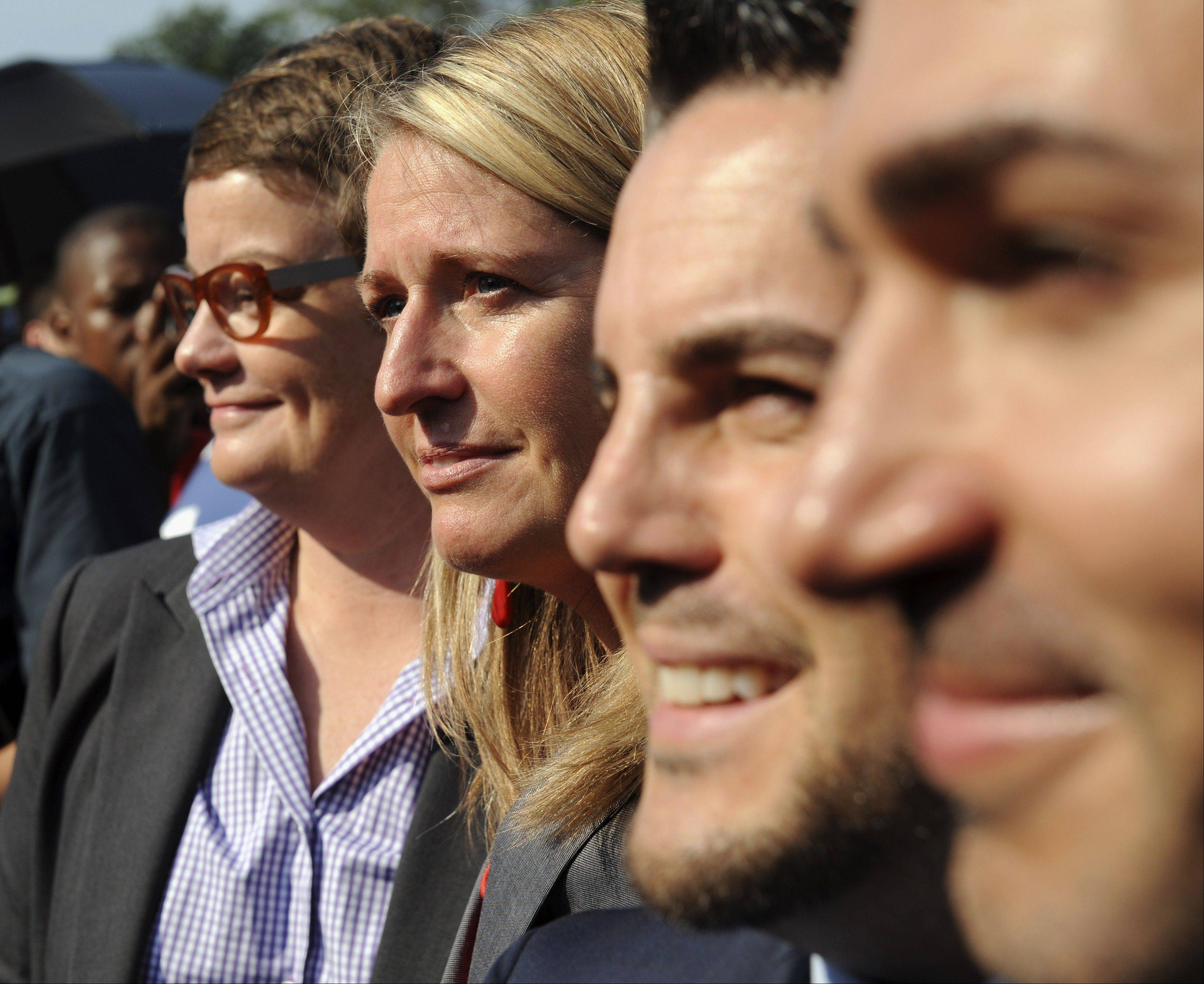 California's Proposition 8 plaintiffs, from left, Kris Perry, Sandy Steir, Jeff Zarrillo, and Paul Katami walk into the Supreme Court in Washington, Wednesday, June 26, 2013. The Supreme Court has cleared the way for same-sex marriage in California by holding that defenders of California's gay marriage ban did not have the right to appeal lower court rulings striking down the ban.
