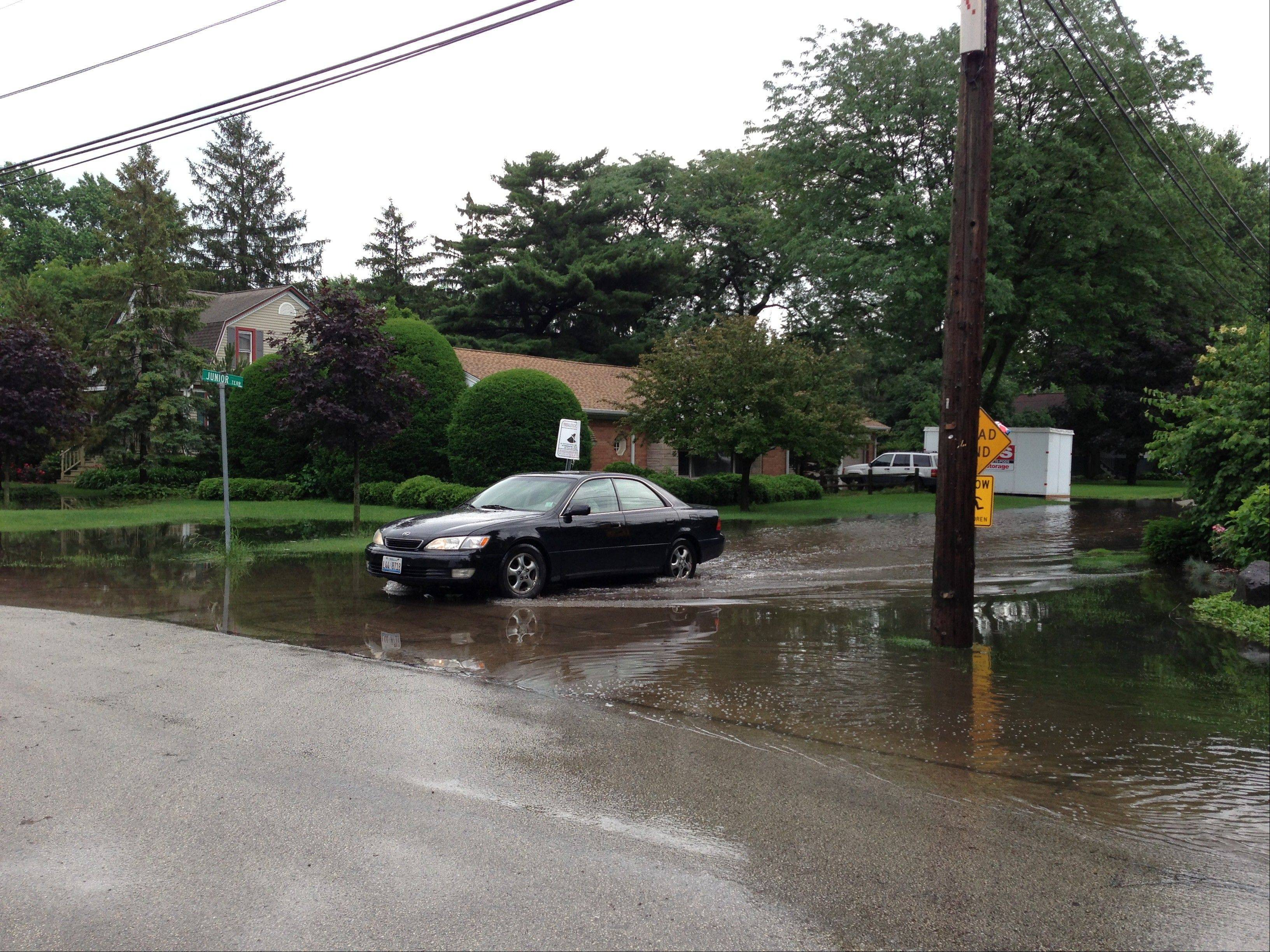 Water was standing Wednesday morning at the intersection of Hawthorne Lane and Junior Terrace near the Big Bend Lake area in Des Plaines.