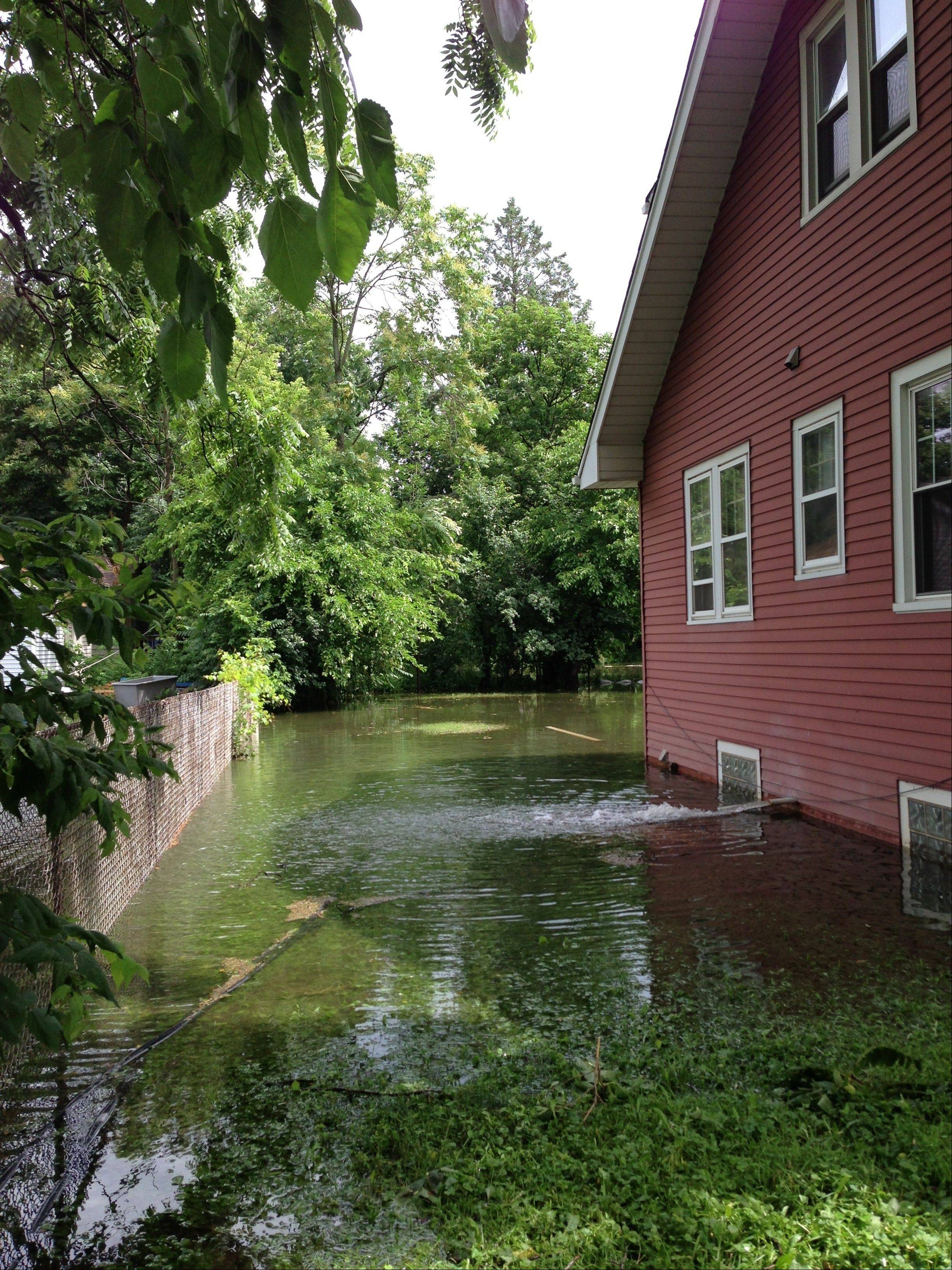 There was backyard flooding Wednesday morning at a home off Rand Road and Hawthorne Lane in Des Plaines near Big Bend Lake.