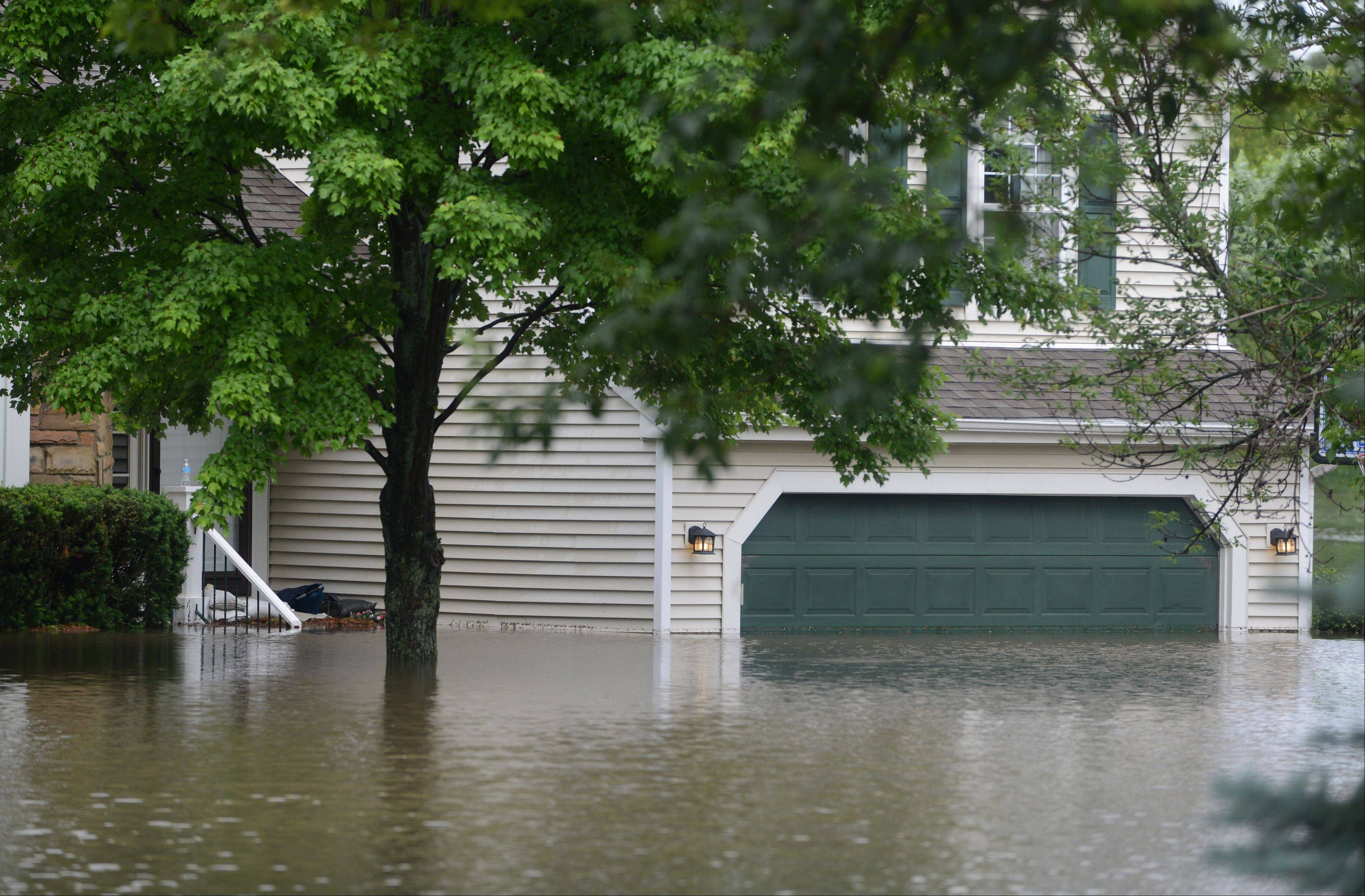 The home of KC Faetz Thistle Lane in Lake Zurich was left underwater after heavy storms hit the area Wednesday morning.