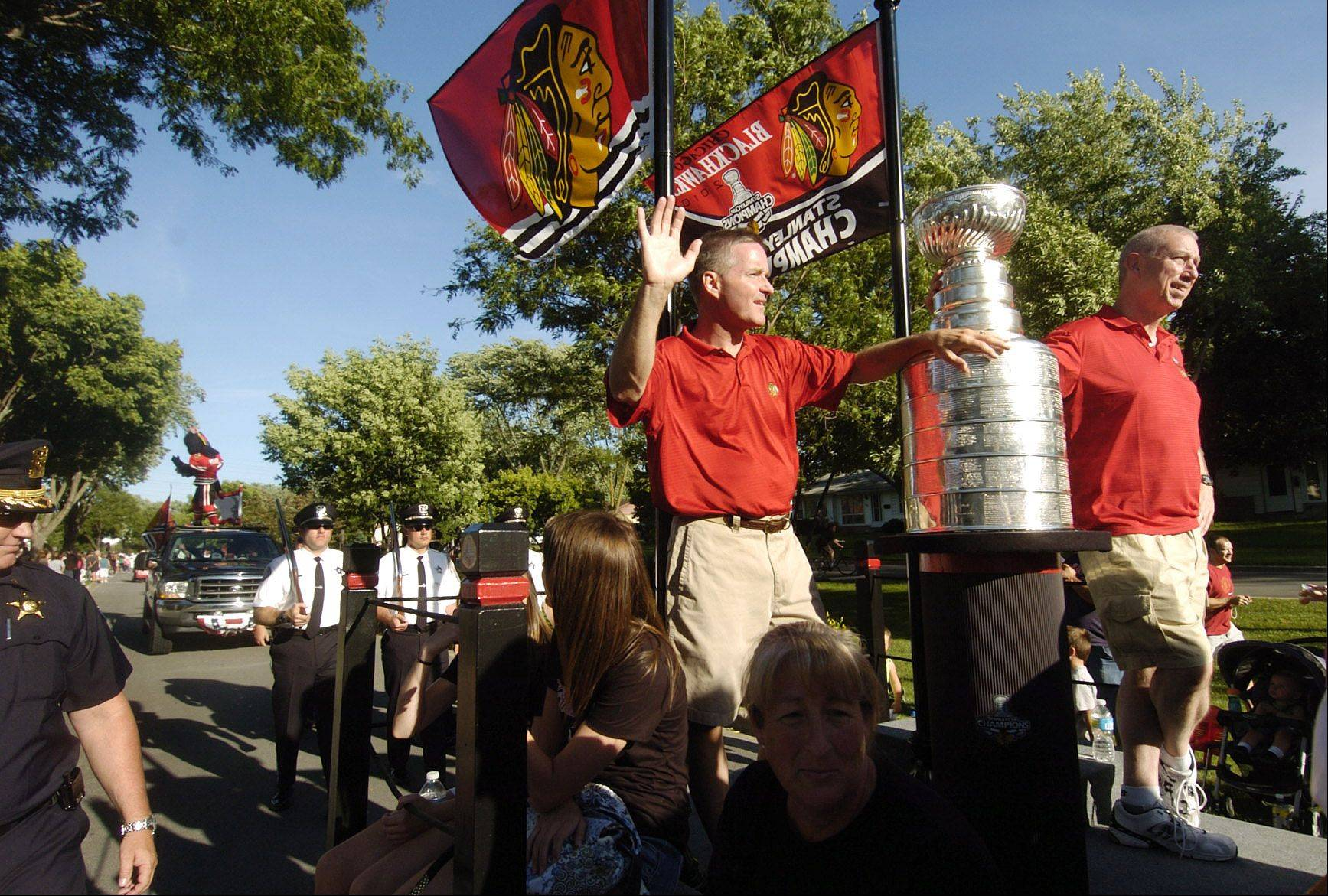Chicago Blackhawks President and Elk Grove Village resident John McDonough, right, and Elk Grove Village Mayor Craig Johnson stand with the Stanley Cup during Elk Grove Village's HomeTown Parade in 2010.