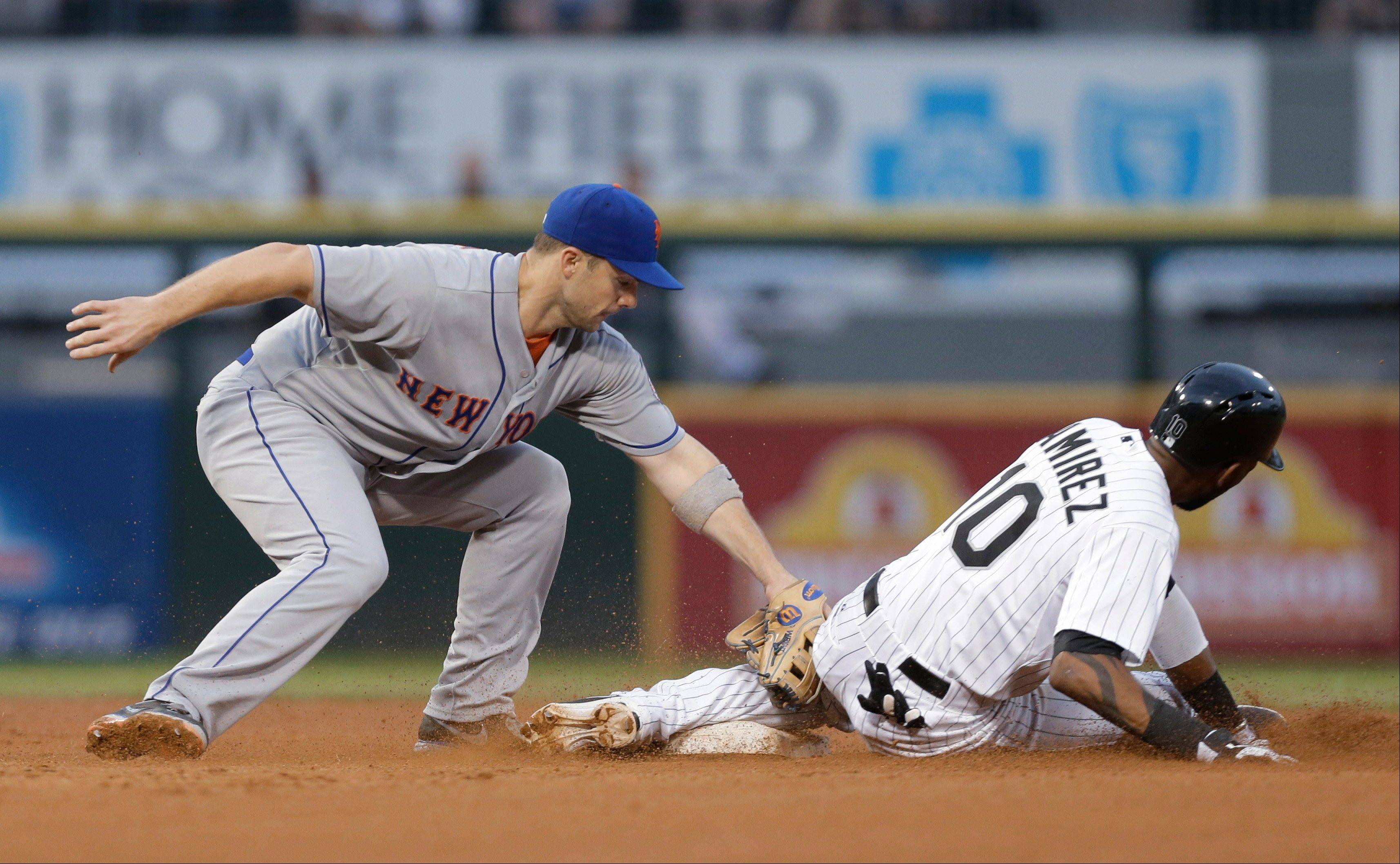 The White Sox' Alexei Ramirez, right, steals second as New York Mets third baseman David Wright applies a late tag during the fourth inning of an interleague baseball game on Wednesday, June 26, 2013, in Chicago.